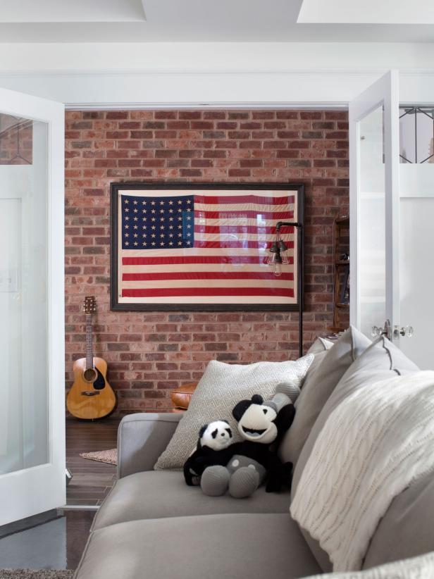 Using American Flags as Decor - love the flag hanging against the red brick wall.