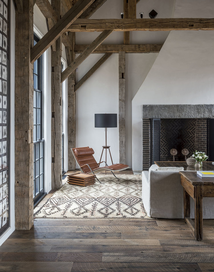 Inspiration for a mountain modern living room with rustic, mid-century, and bohemian touches. Love the moroccan rug and rustic beams.