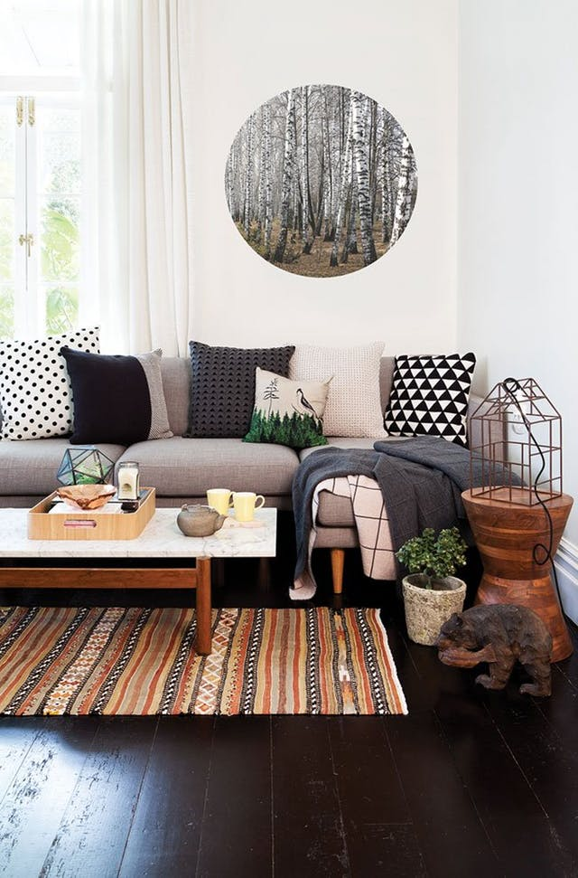Inspiration for a mountain modern living room. Love the tribal, mid-century, and rustic touches.
