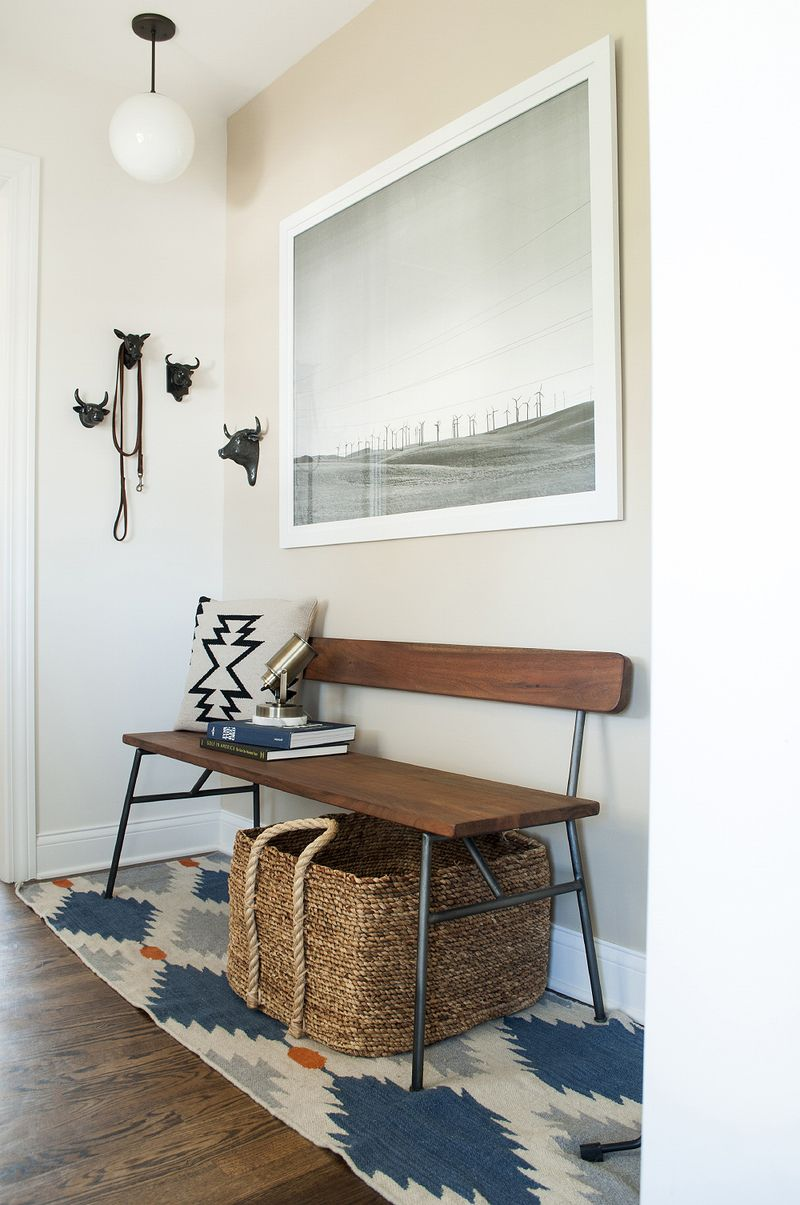 A modern bench from CB2 makes for a functional and pretty entryway in this home. For more ways to use benches in your home, head to the blog post!
