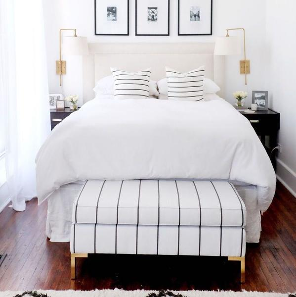 A striped bench at the end of the bed is functional and pretty. For more ideas on how to use benches in your home, head to this blog post!