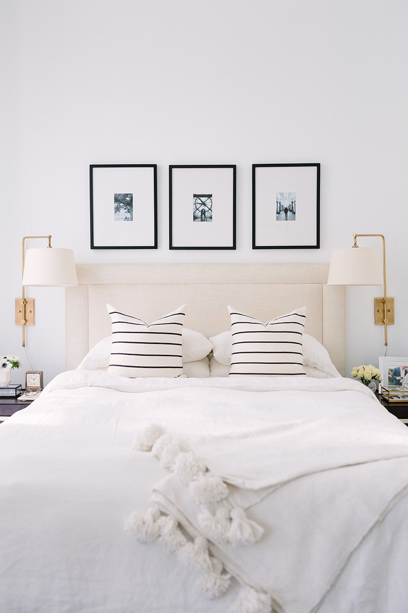 Love the look of this black and white bedroom with a classic transitional style. The striped pillows and brass plug-in sconces are great details. See how you can get a similar look in your own home over on the blog!
