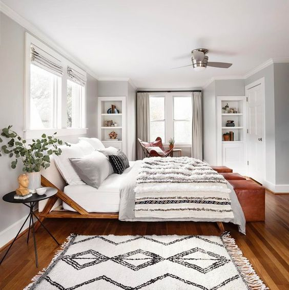 Love the look of this black and white bedroom with a modern boho eclectic style. The textured throw and moroccan shag rug are great details. See how you can get a similar look in your own home over on the blog!