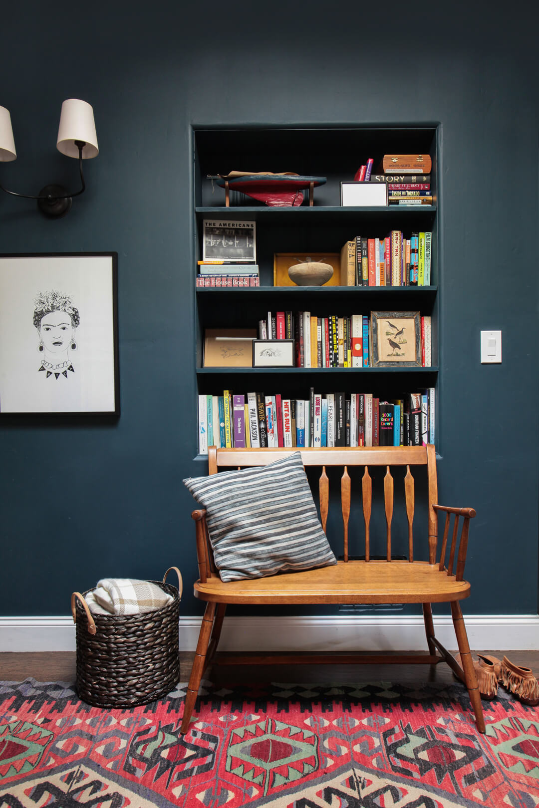 I've been loving dark paint colors lately - especially navy, deep teal and green, and dark charcoal. This modern meets traditional reading nook is a perfect example of how beautiful dark teal wall paint can be!
