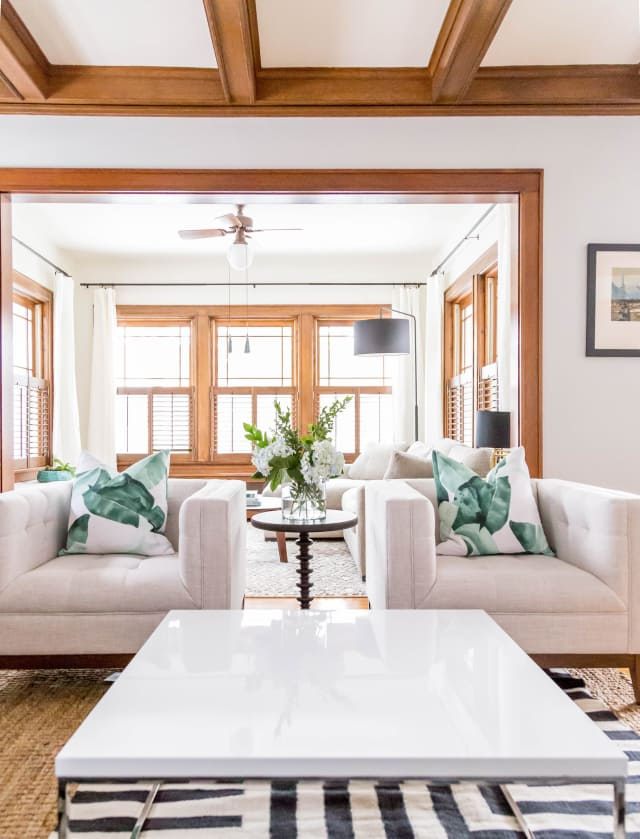 Working with wood trim can be a challenge, but this transitional modern living room proves that it can be done well! They kept things bright and airy with white and light colored furniture and decor.