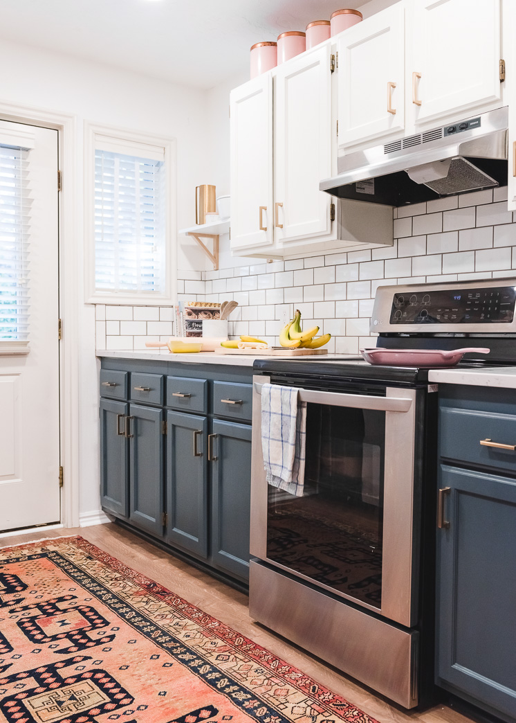 Need help picking out window treatments? I've got you covered! This simple, but thorough guide will walk you through how to choose curtains, shades, and blinds for your home. I love this navy and brass kitchen with the vintage runner.
