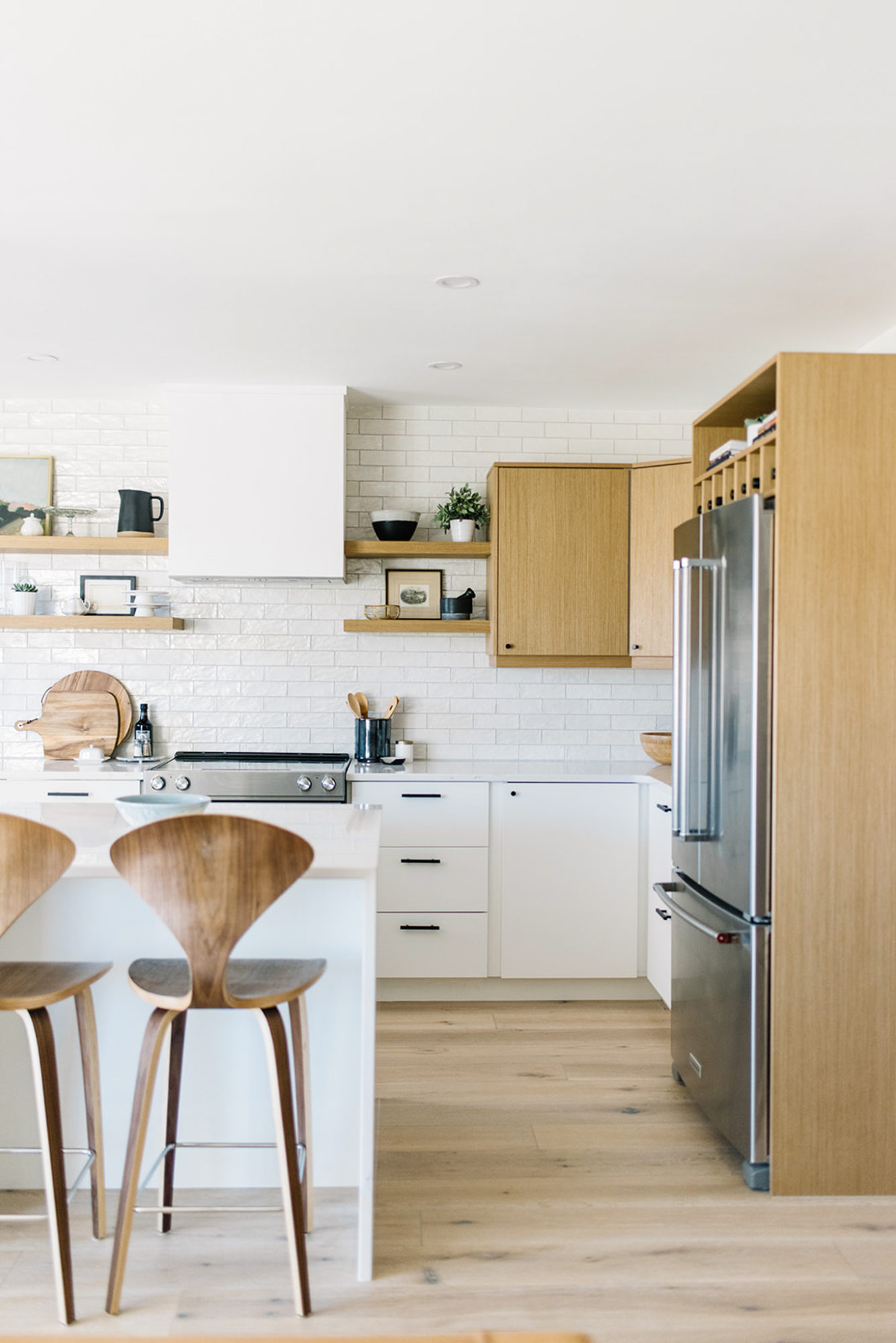 One Room Challenge Fall 2018 | This modern Scandinavian kitchen makeover is beautiful with its two-tone cabinets, white subway tile, and white oak floors.