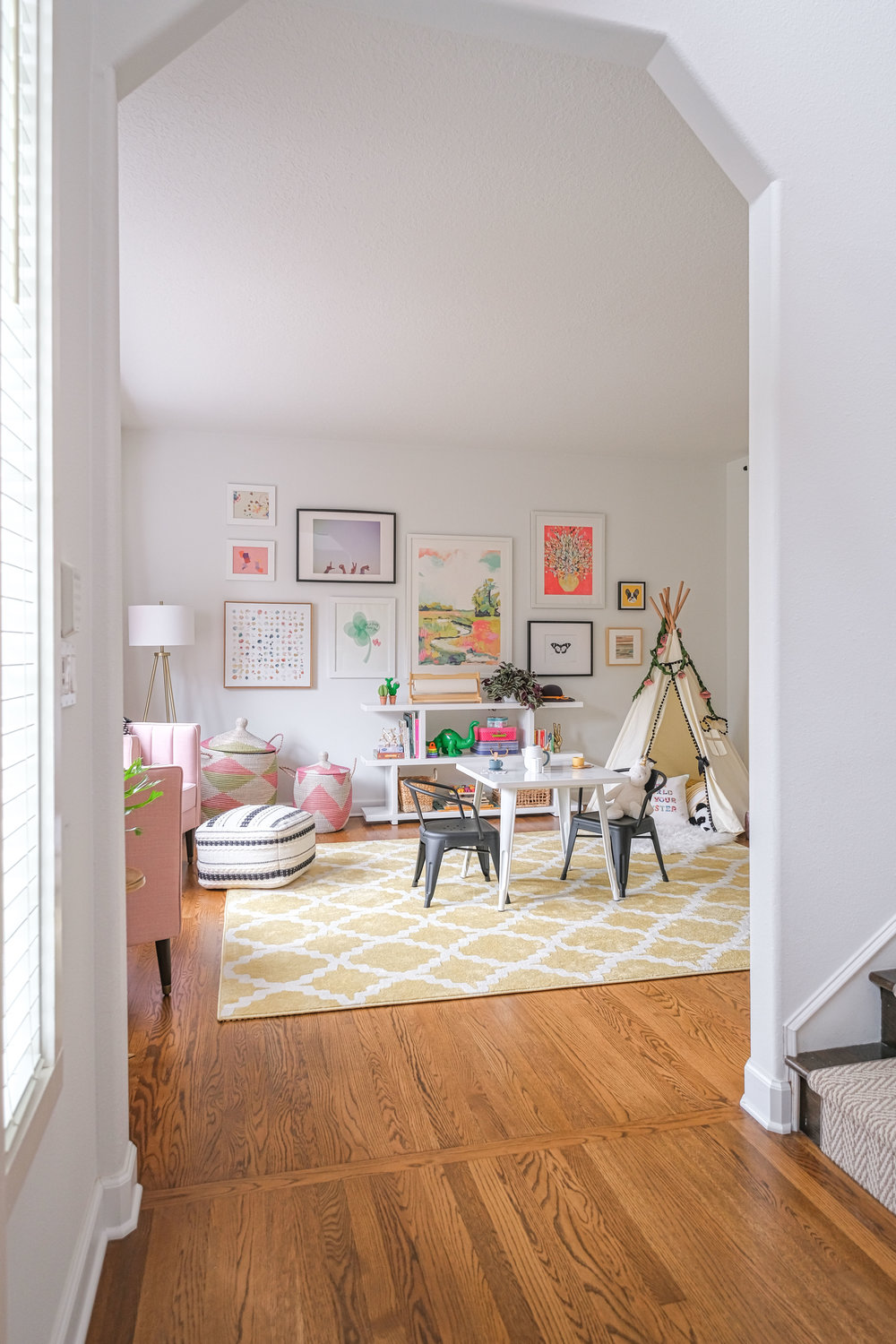 One Room Challenge 2018 | This colorful playroom is functional and stylish! With the gallery wall, open modern bookshelf, and kids play table, it's ready to grow with the kids as they get older.