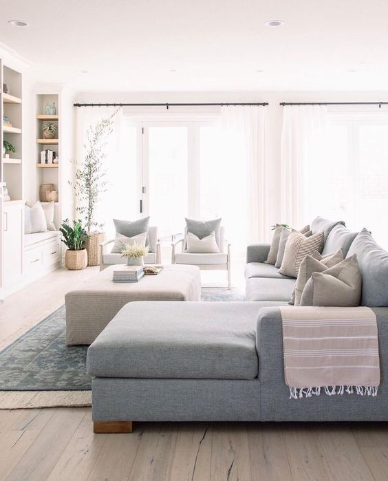 Need help with how to choose a coffee table or ottoman for your living room? I've got you covered! I'll walk you through what you need to think about when you're shopping for one for your home. Plus, I've got a roundup of my favorite coffee tables and ottomans to help you get started in your search. // Modern coastal eclectic living room