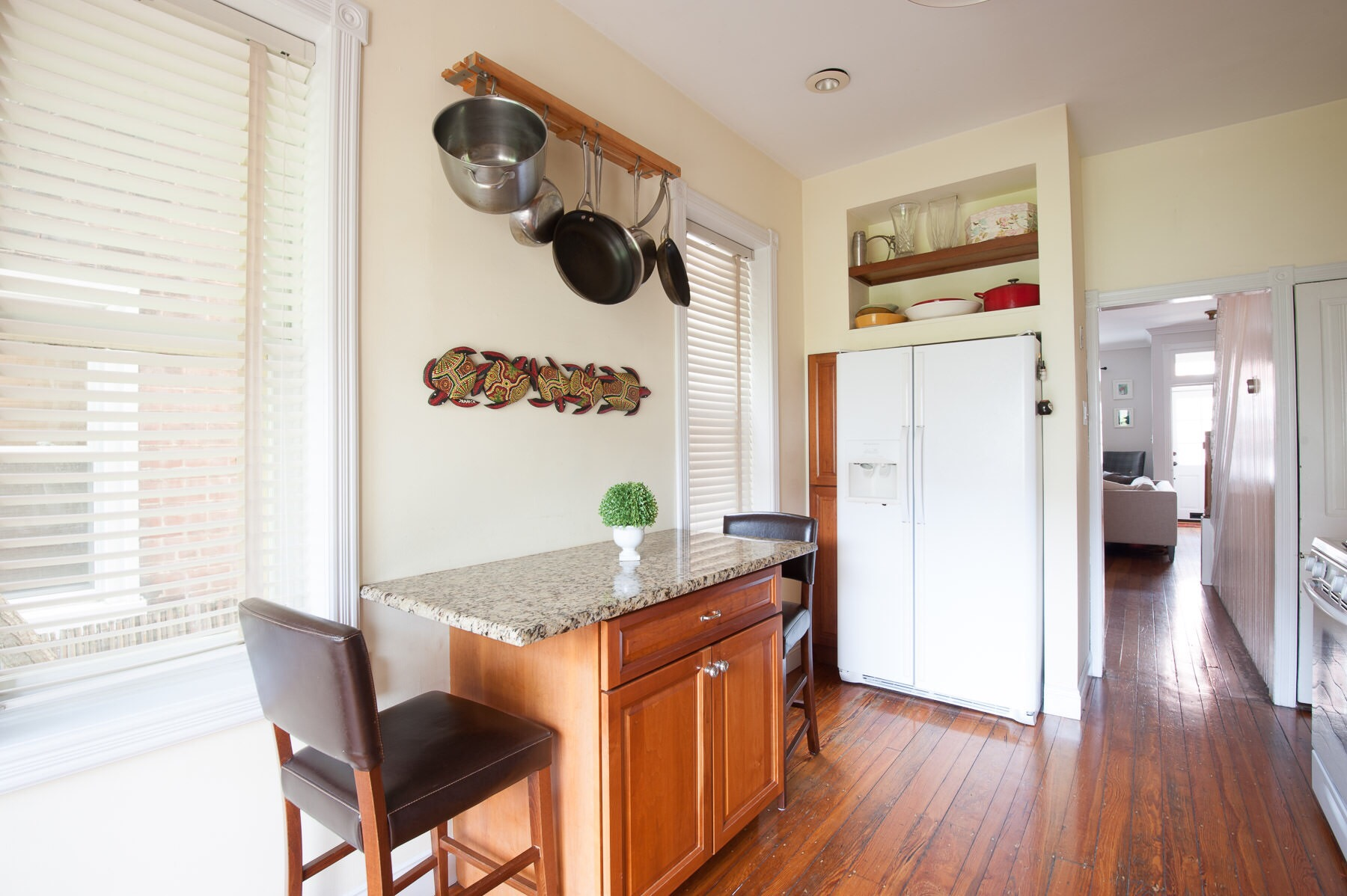 A Philadelphia Row House gets a makeover without renovating. Here's the before - the brown on brown wasn't working for this family, but the cabinets were in good shape, so they opted for a refresh instead of a full renovation.