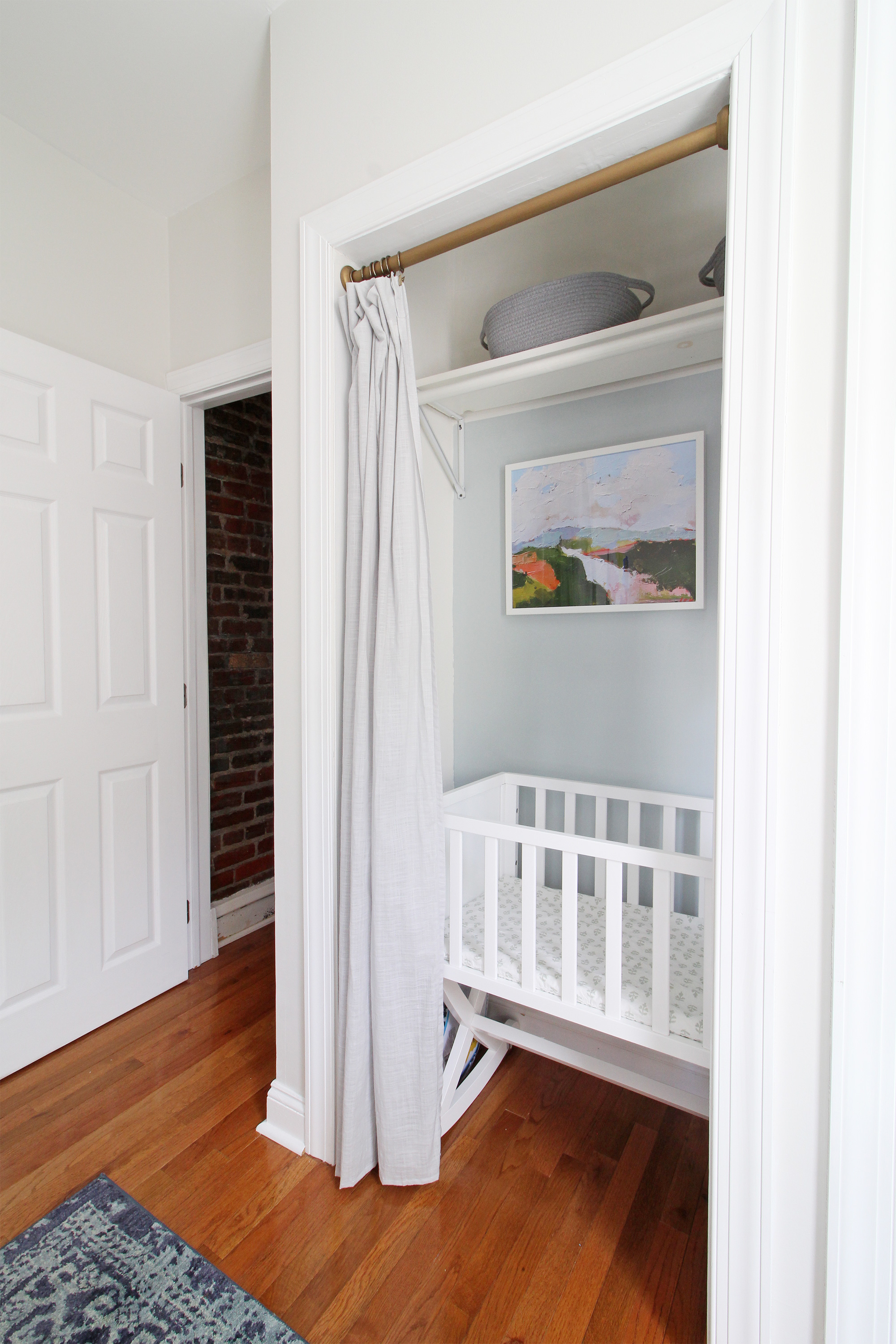 "Come on over to the Mix & Match Design Company blog for this cozy modern nursery nook reveal! This space is shared with a home office and is full of great ideas on how to squeeze in a small nursery into a closet. The ""nursery nook"" concept is perfect if you live in a smaller home. Bassinet in closet."
