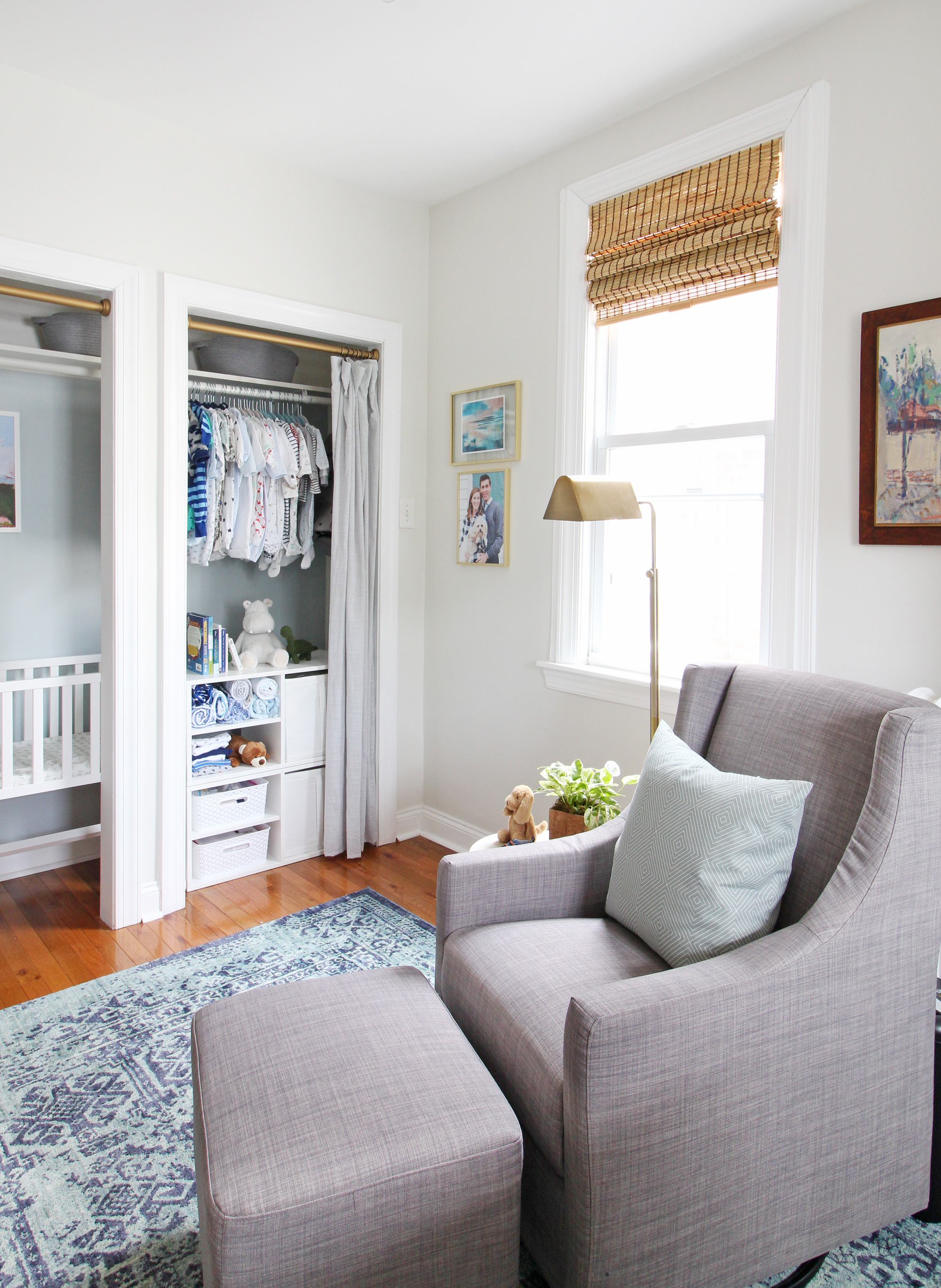 """Come on over to the Mix & Match Design Company blog for this cozy modern nursery nook reveal! This space is shared with a home office and is full of great ideas on how to squeeze in a small nursery into a closet. The """"nursery nook"""" concept is perfect if you live in a smaller home. Gray glider in a blue nursery."""