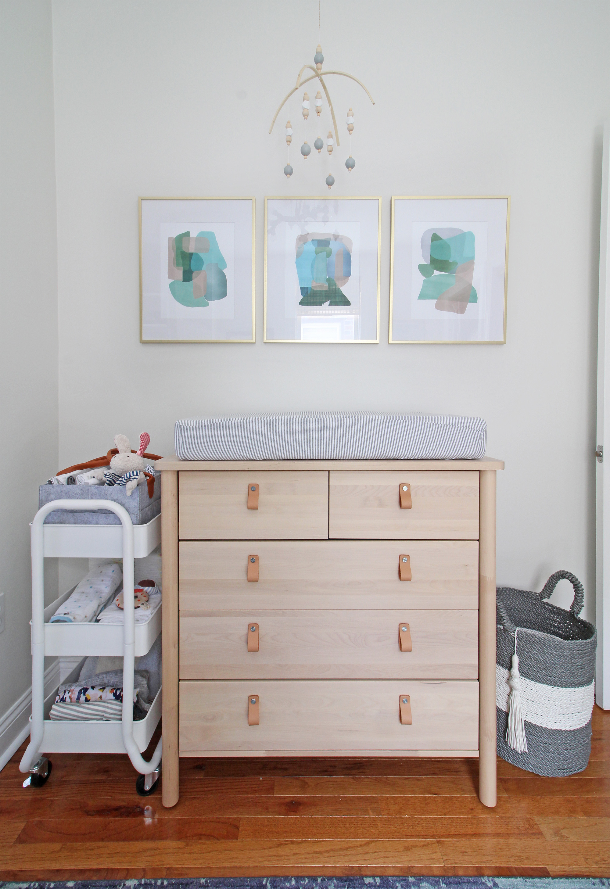 "Come on over to the Mix & Match Design Company blog for this cozy modern nursery nook reveal! This space is shared with a home office and is full of great ideas on how to squeeze in a small nursery into a closet. The ""nursery nook"" concept is perfect if you live in a smaller home. Eclectic modern nursery."