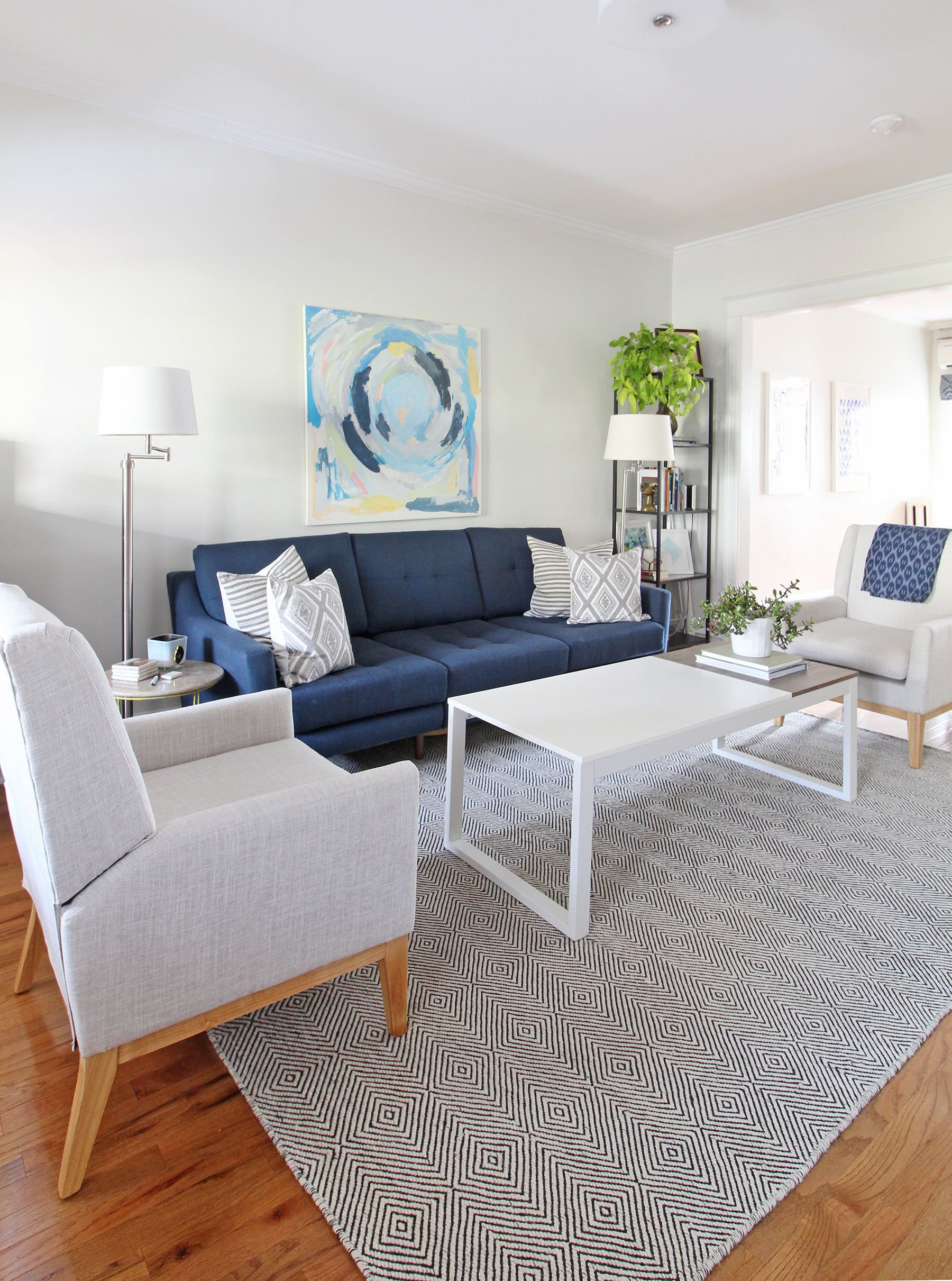A 1930s row home in Philadelphia gets a big makeover. Come see the before and after of this home's living, dining, and kitchen open floor plan and get ideas for small space city living. Chaney's style is mid-century modern meets traditional that makes for an eclectic, cozy space.