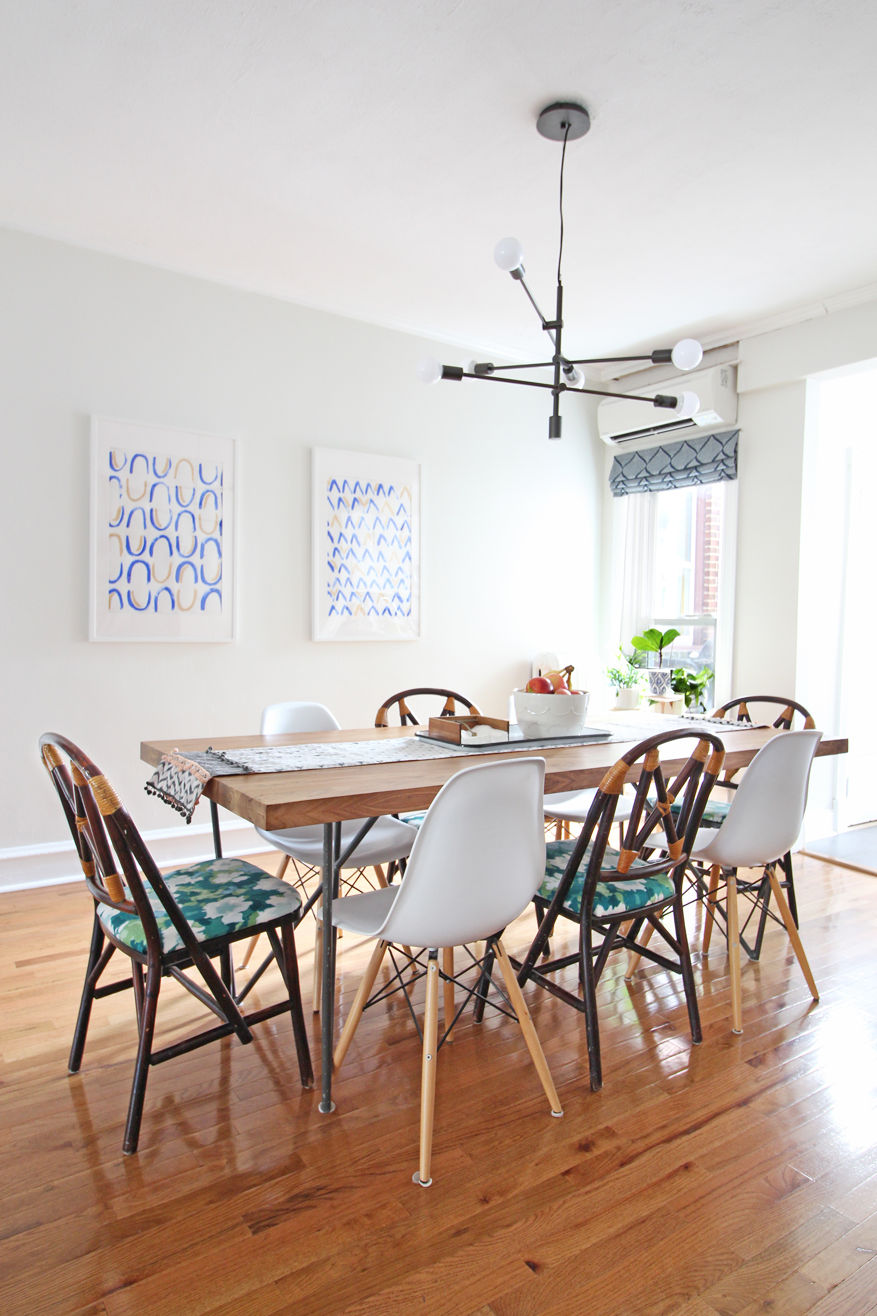 A 1930s row home in Philadelphia gets a big makeover. Come see the before and after of this home's living, dining, and kitchen open floor plan and get ideas for small space city living. Chaney's style is mid-century modern meets traditional that makes for an eclectic, cozy space. The dining table was a Craigslist find and her mix of dining chairs continues the eclectic vibe.