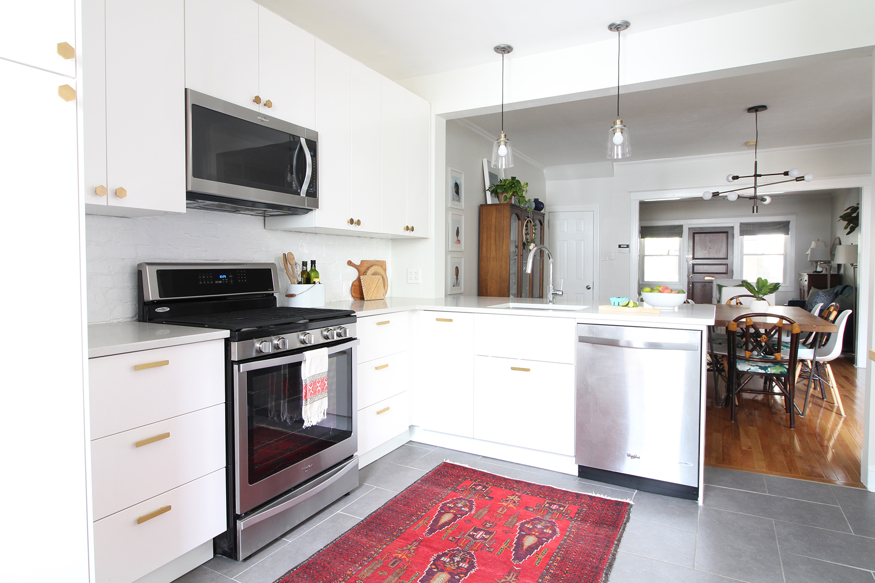 A 1930s row home in Philadelphia gets a big makeover. Come see the before and after of this home's living, dining, and kitchen open floor plan and get ideas for small space city living. Chaney's style is mid-century modern meets traditional that makes for an eclectic, cozy space. IKEA Sektion cabinets and marble-look quartz countertops in a modern kitchen.