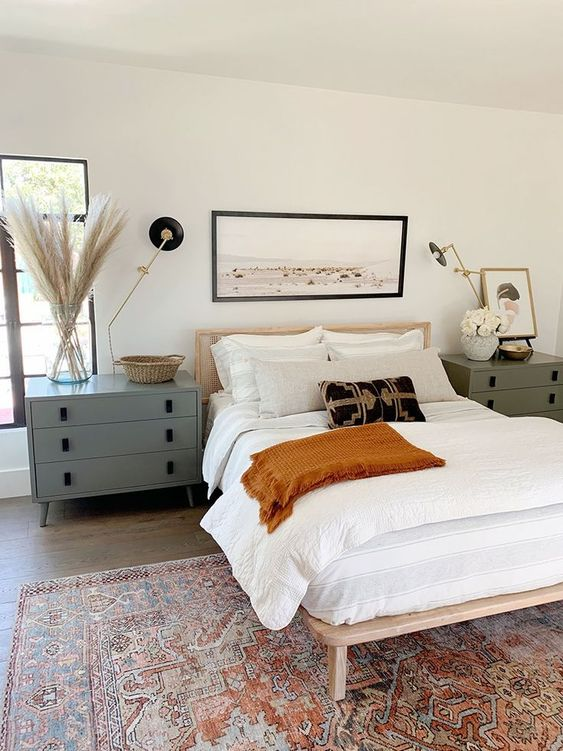 Find tips for shopping affordable vintage-style rugs. Beautiful modern traditional bedroom with vintage style rug.