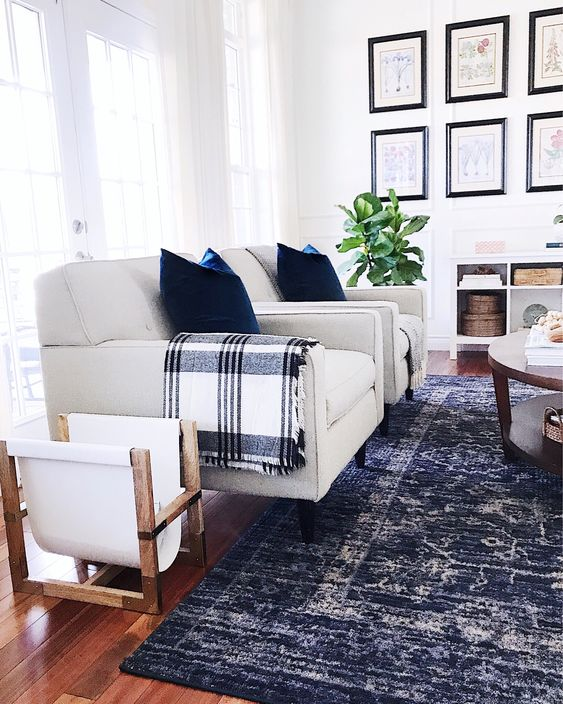 Find tips for shopping affordable vintage-style rugs. Beautiful modern farmhouse living room with vintage style rug.