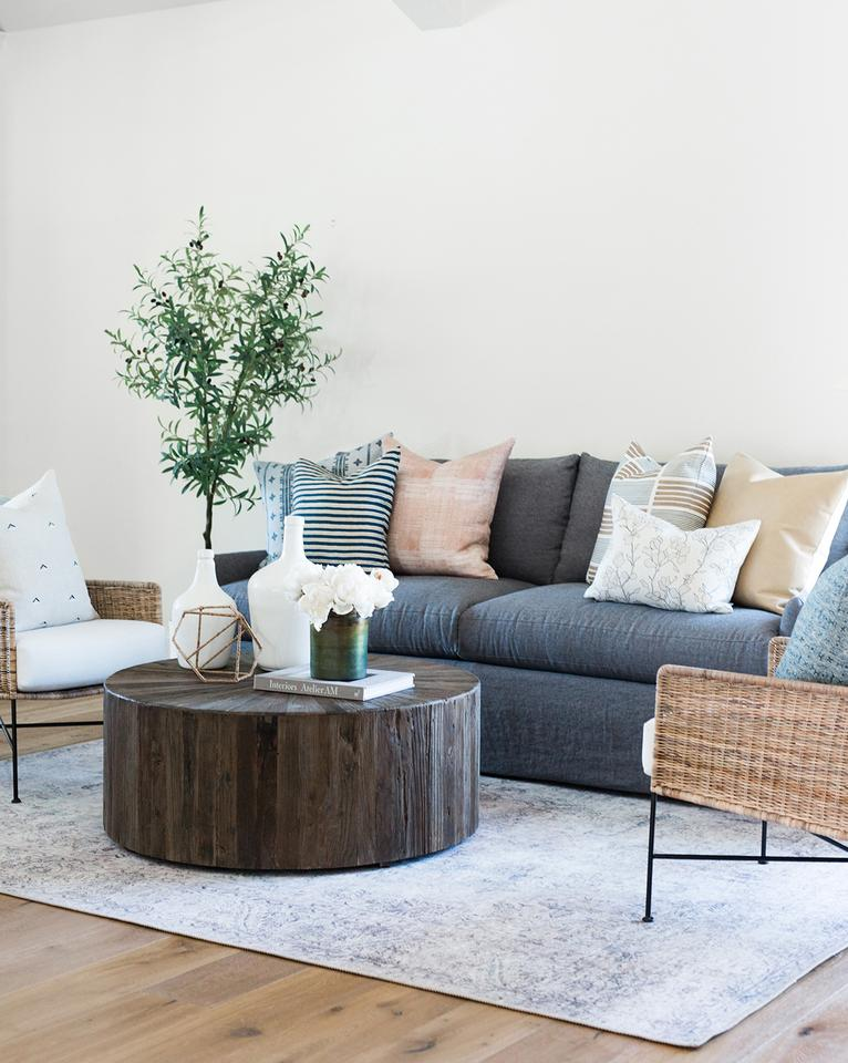 Find tips for shopping affordable vintage-style rugs. Beautiful modern traditional living room with vintage style rug.