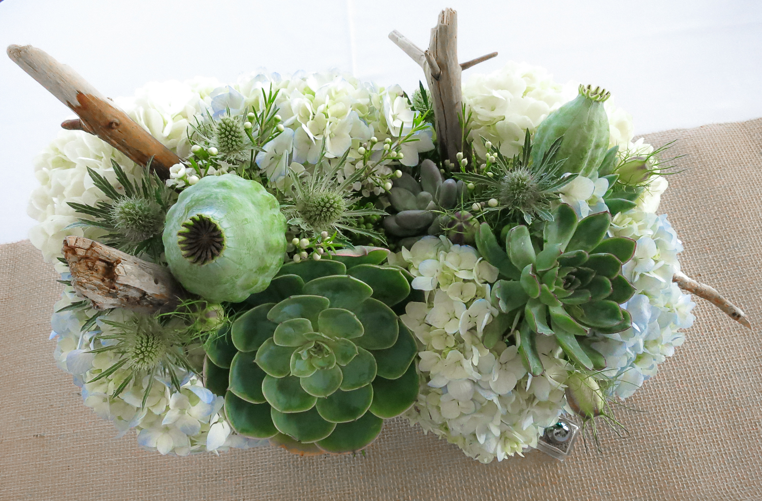 Succulent, Poppy Pod, Hydrangea, Sea Thistle, Centerpiece by Pebble and Branch Floral Design
