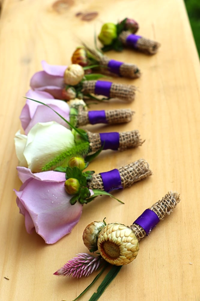 Purple Rose, Straw Flower, and Dahlia Bud Boutonnieres Pebble and Branch Floral Design
