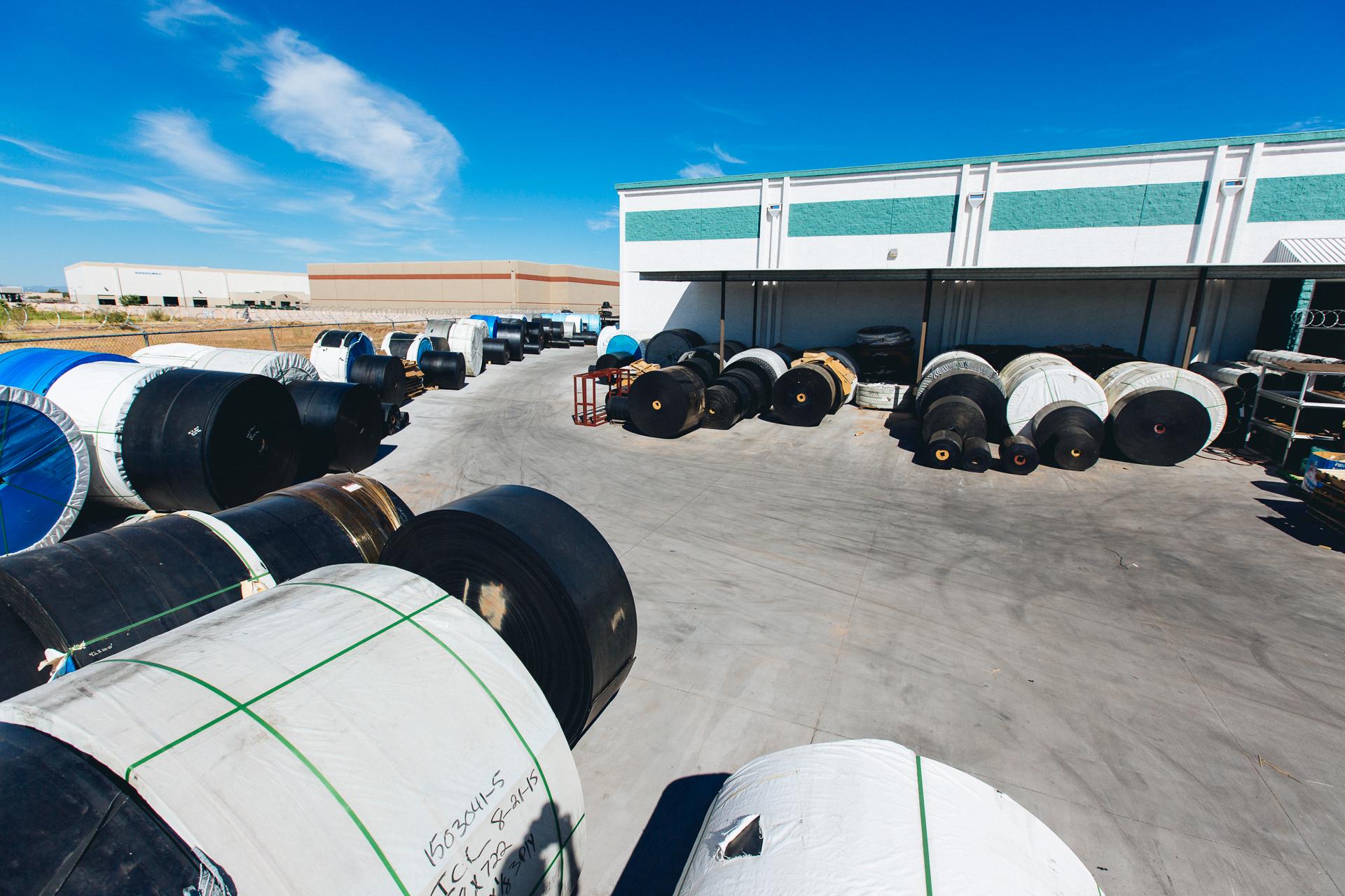 Conveyor belt reels on yard