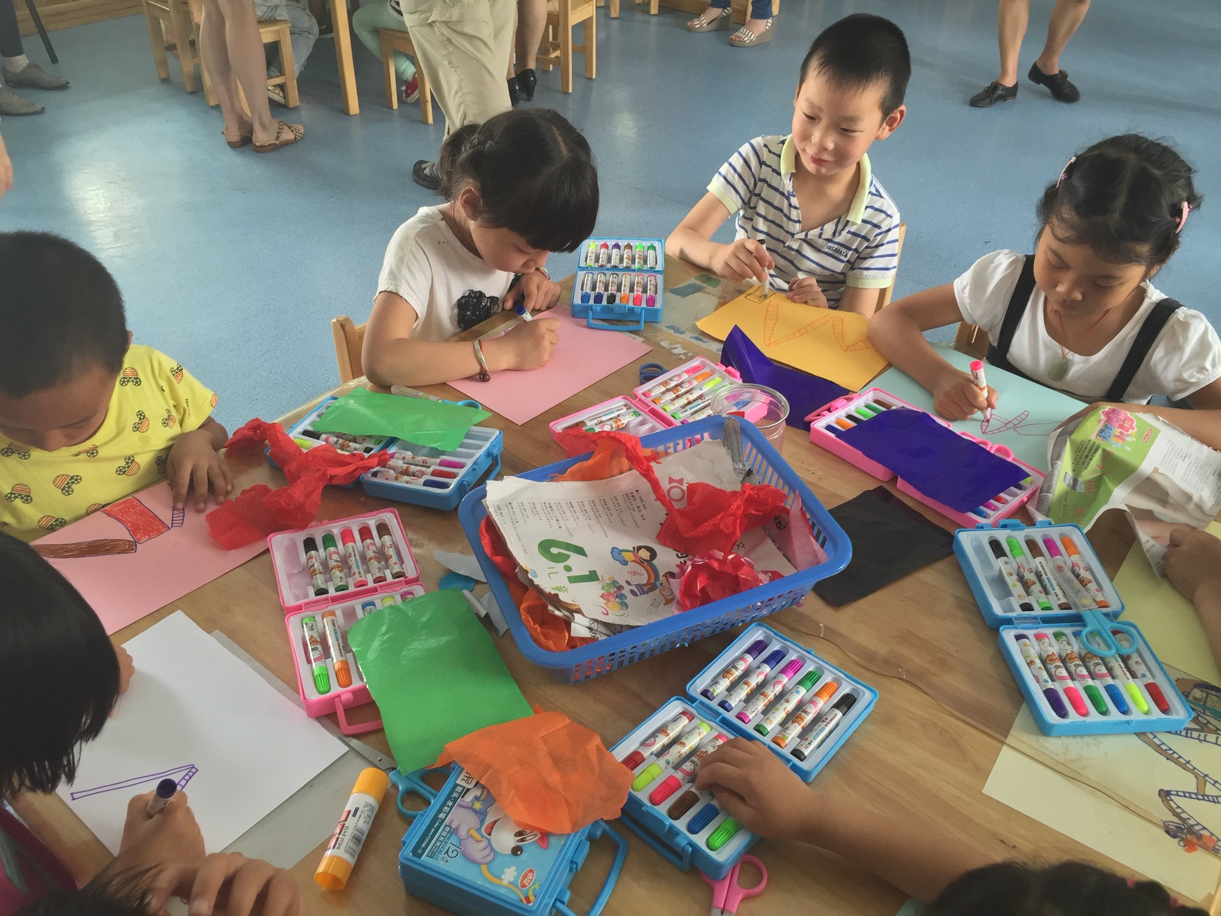Children in Anji drawing and writing their Play Stories.