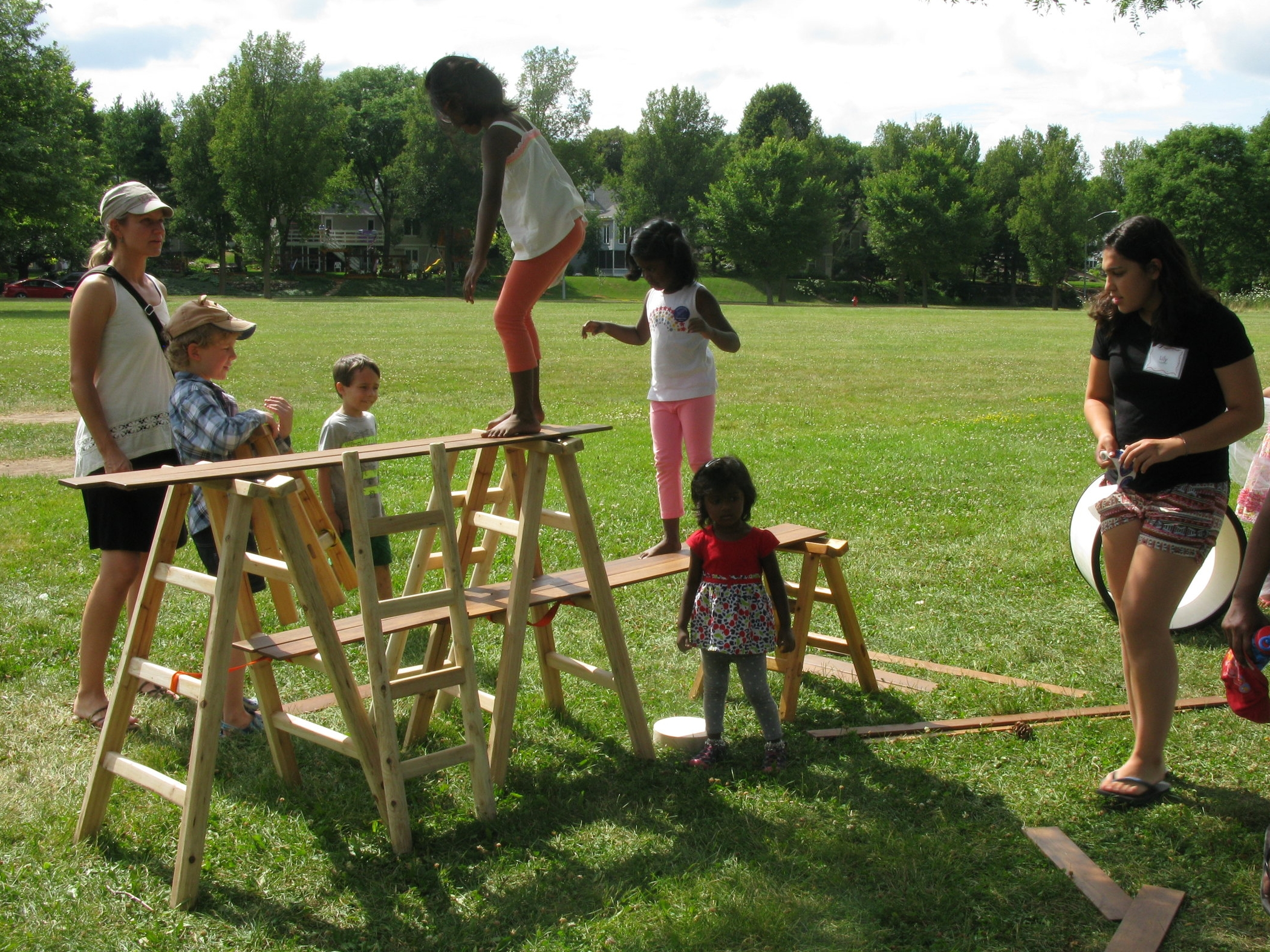 Parents support their children's experience of True Play at Madison Public Library's Anji Play drop-in program.