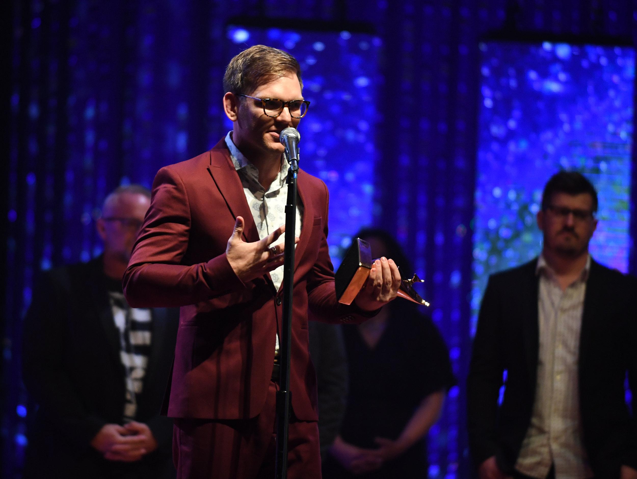 Rick Seibold accepts award at the 49th Dove Awards