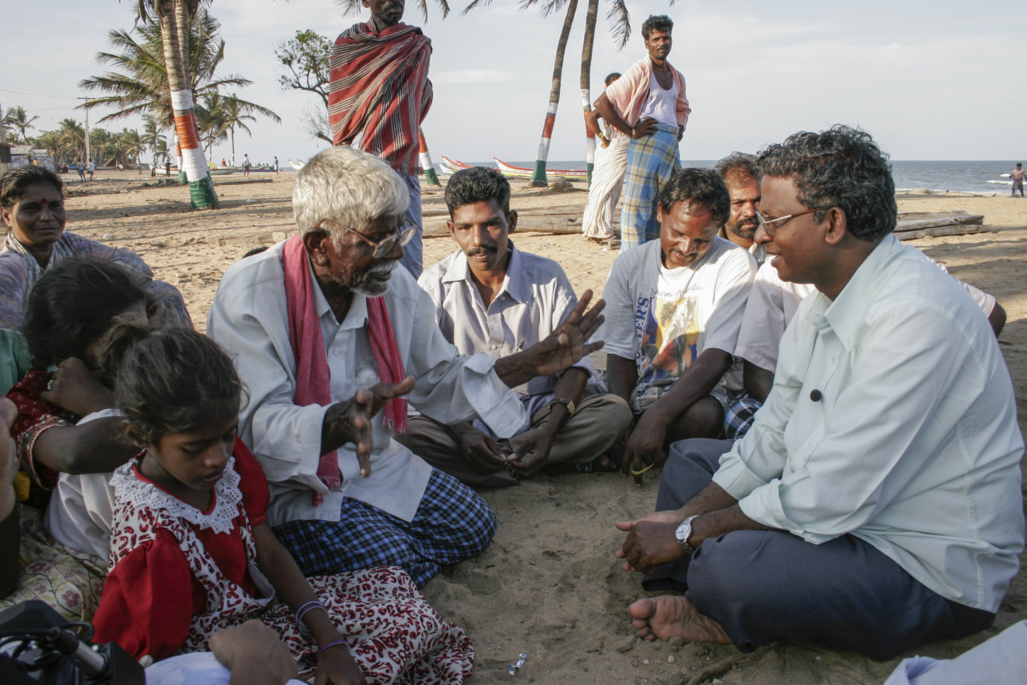 """Fr. Jesumarian, S.J. meets with a group of villagers affected by the tsunami. He is a lawyer who has led a crusade to combat discrimination against India's Dalits, formerly called """"untouchables,"""" the lowest Hindu Caste."""
