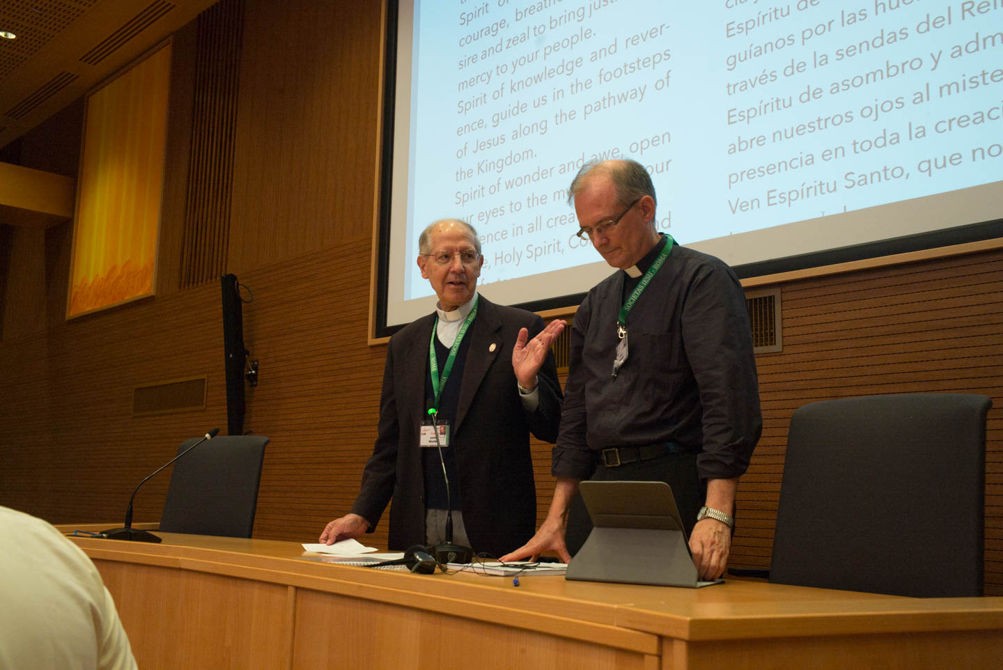 Adolfo Nicolás hands over the meeting to Jim Grummer, SJ, as vicar of GC36. Afterwards, Adolfo took his seat among the delegates for a few session before departing GC36.