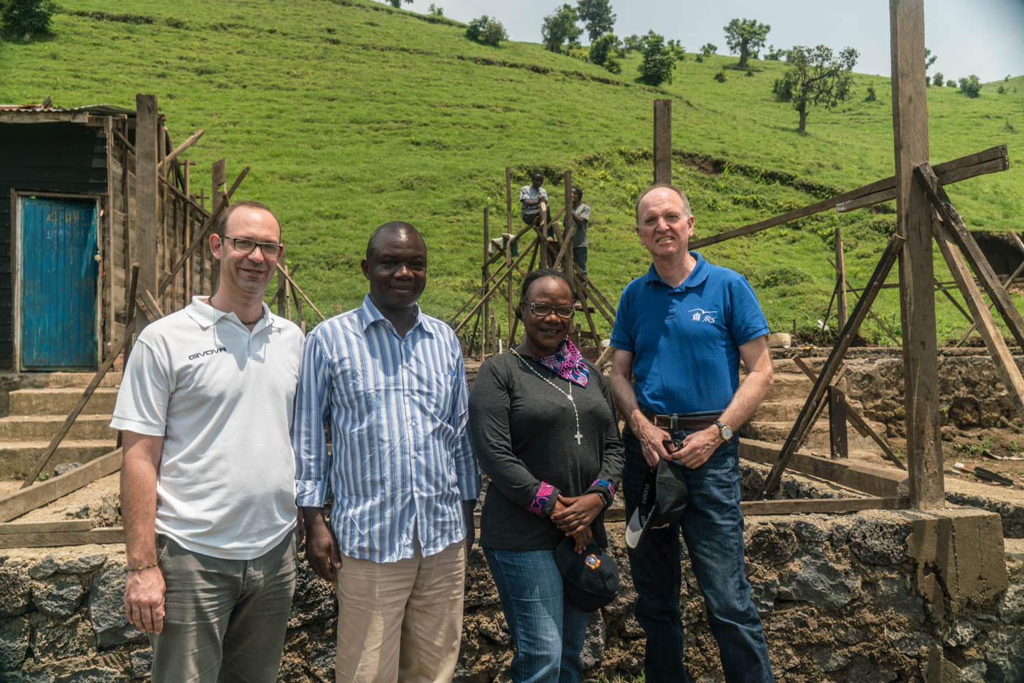Fr. Tom Smolich, International director of Jesuit Refugee Service, visits a JRS sponsored school building site with the local coordinator, a local priest and the construction manager, Lillan.