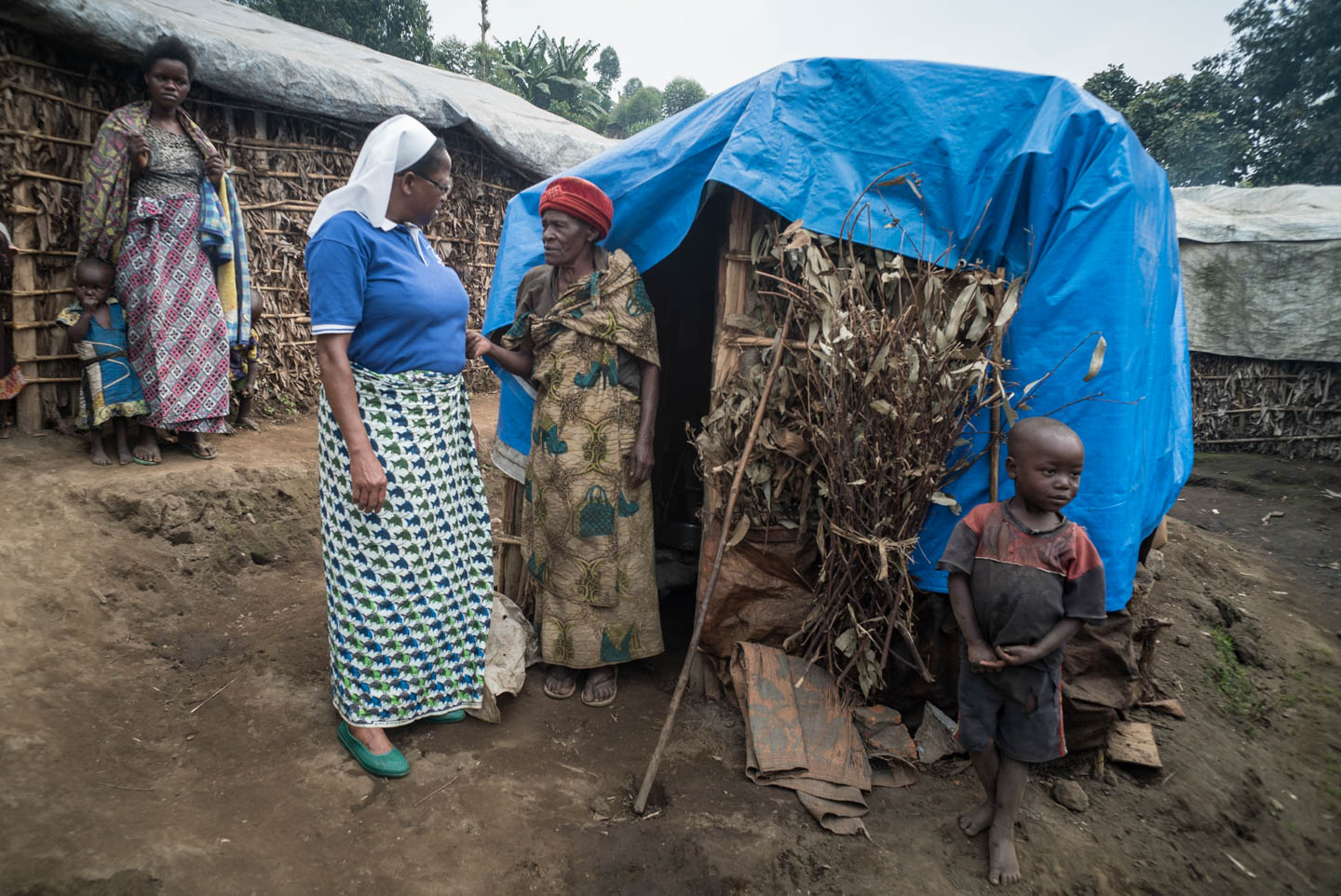 Sr Regina Missanga visits Cecilia, a resident of the Kalinga refugee camp for internally displaced persons (IDP) outside of Misisi. JRS provided her a shelter which cost about $29.