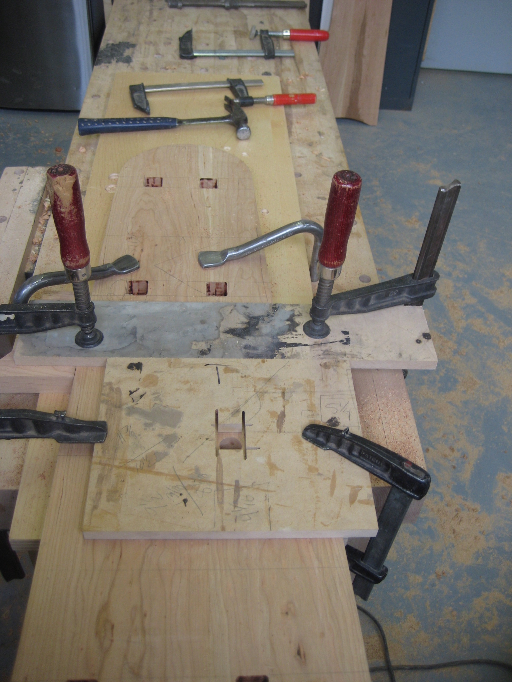 Then, using a router template and collar, and being careful to mark my layout lines, I routed more of the square hole out.