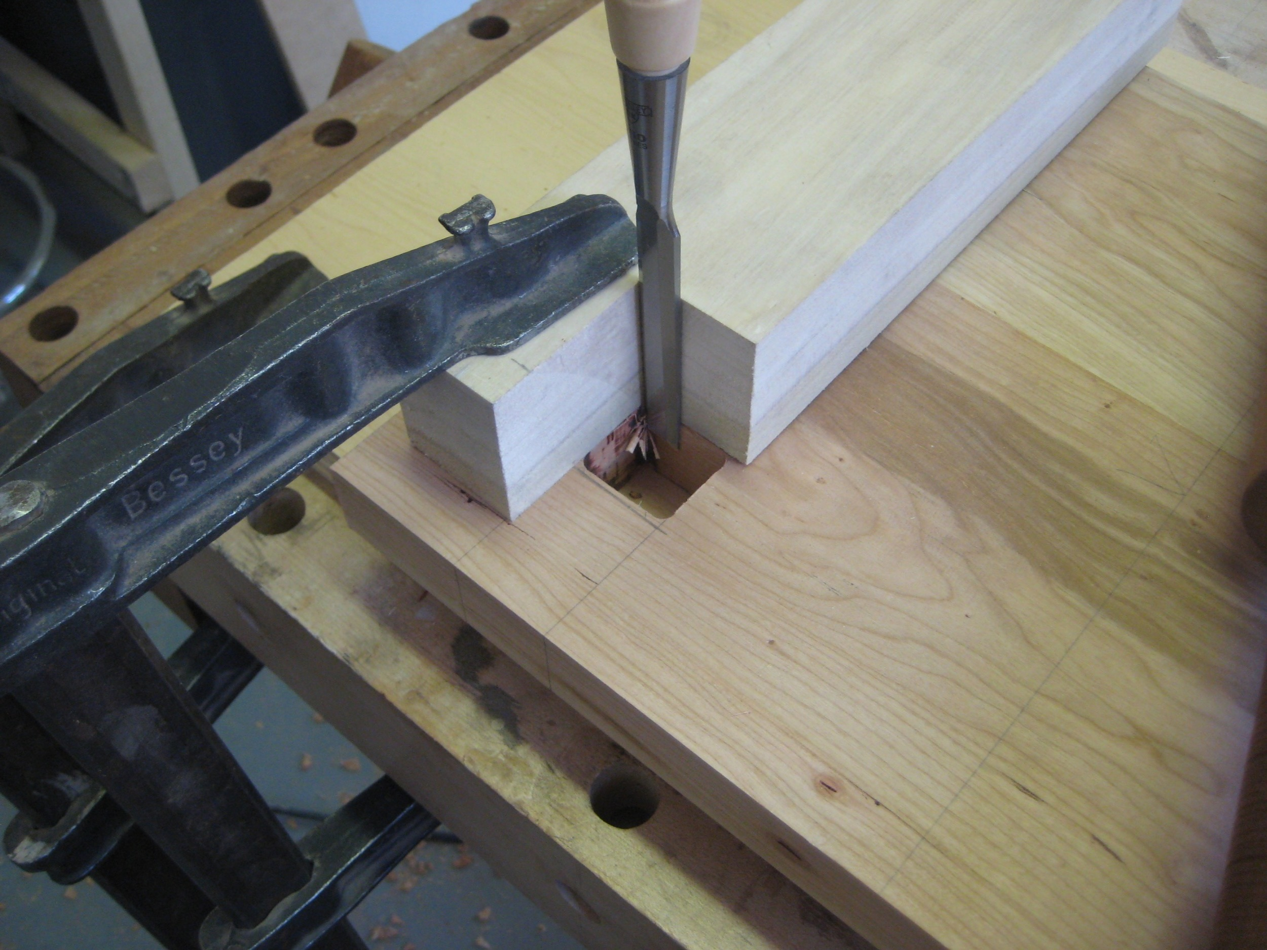 Finally I chopped out the corners left by the router to make a perfect square hole.