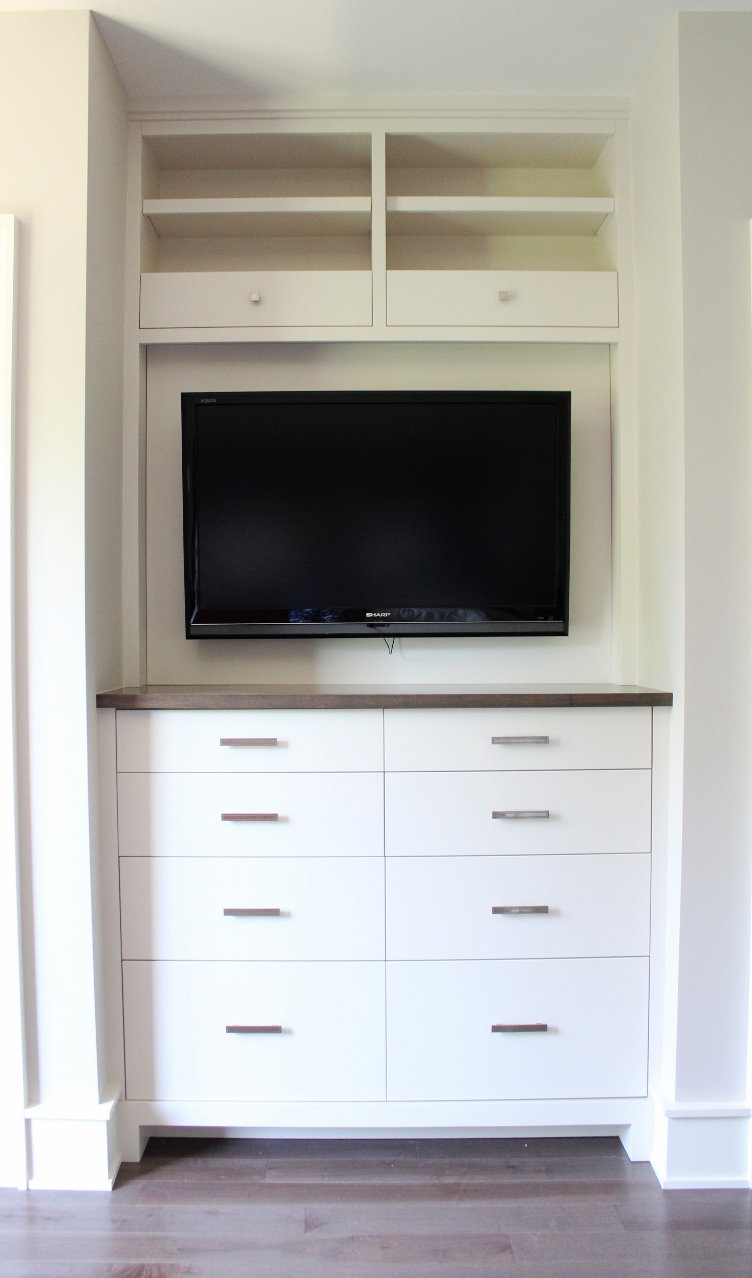 Master Bedroom built in dresser with TV above and electronics storage.