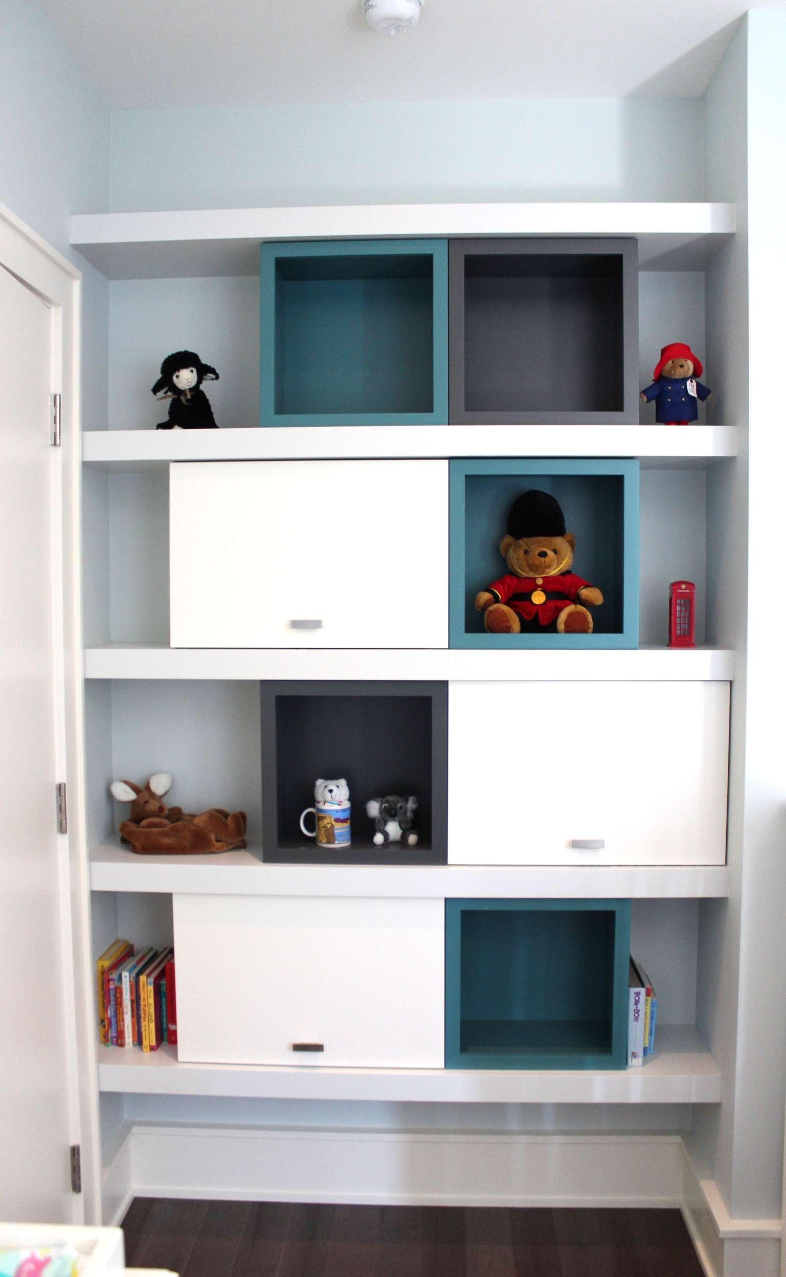 Modular Kids shelving designed to be playful and fun, as well as functional for open faced as well as cabinet storage.