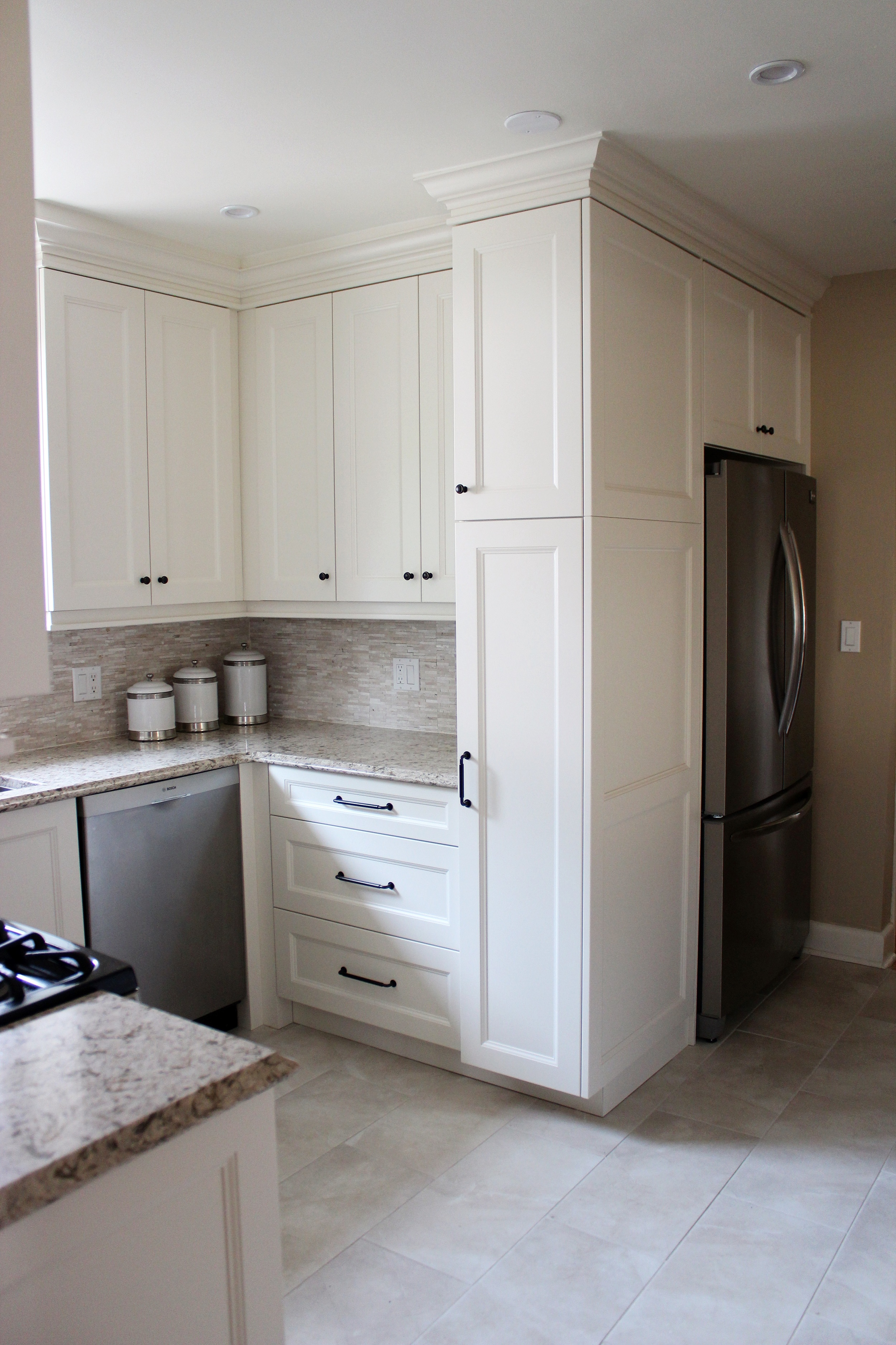 Full height pantry uses ALL the space: helps to build in the fridge, as well as amp up storage.