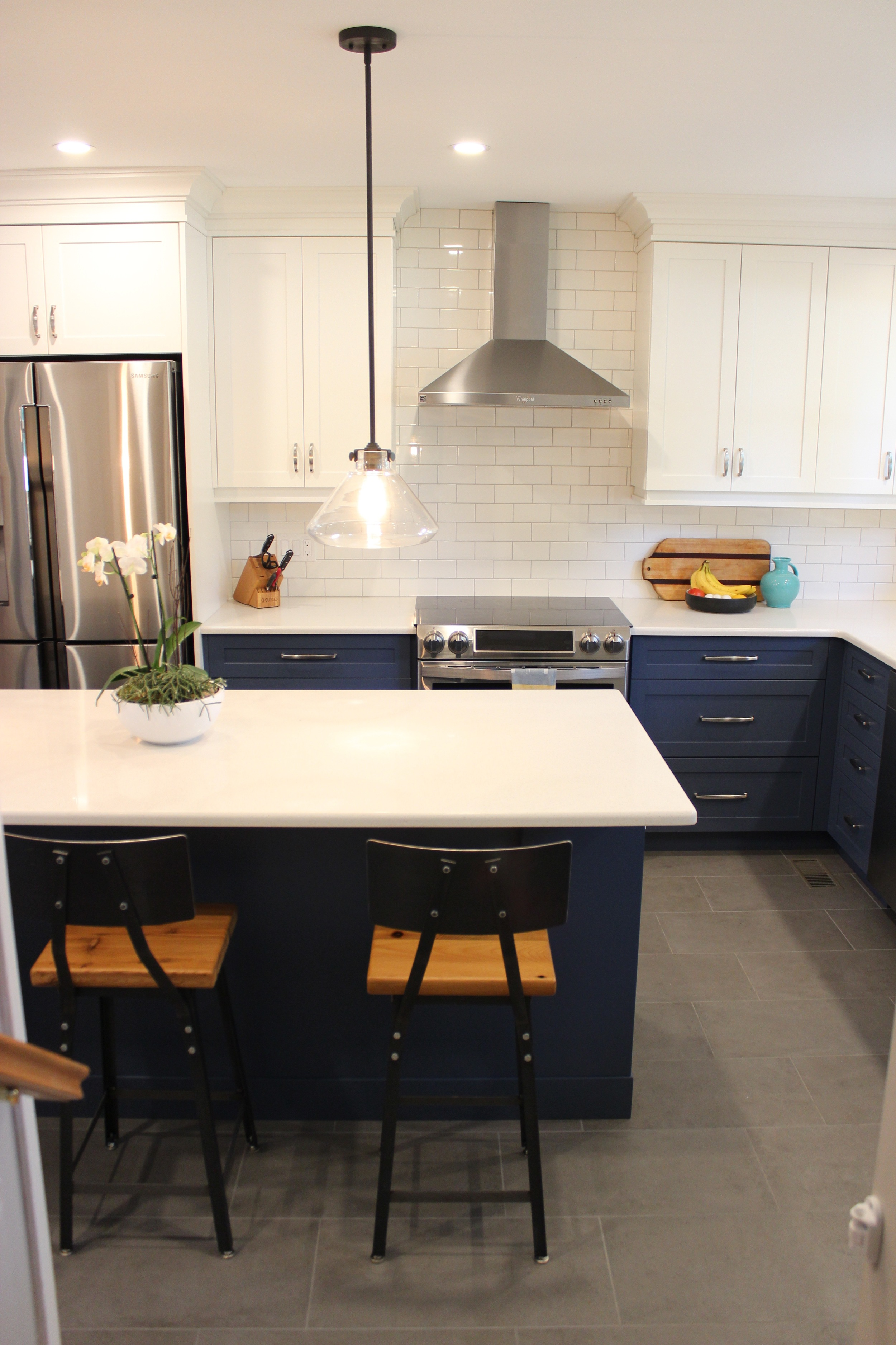 Stainless steel, white, blue, and natural wood work together nicely