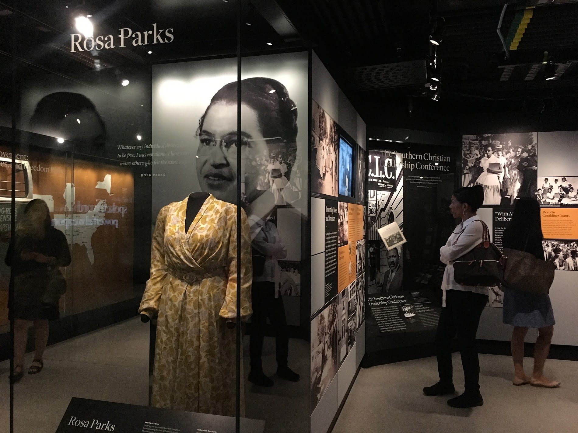 "THE MODERN CIVIL RIGHTS MOVEMENT. This exhibit area maps the Civil Rights movement up until 1968 and displays a collection of ""treasure"" artifacts of the era, including: Rosa Parks dress (ABOVE), a   lunch counter stool from the sit-in in Greensboro, NC; a watch given to Bayard Rustin from Martin Luther King, Jr; and   ten shards of stained glass and one shotgun shell from the 16th Street Baptist Church bombing in Birmingham, AL.  Photo credit: Aki Carpenter"