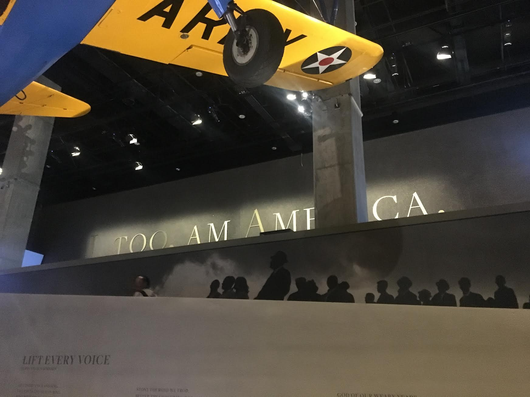 I, TOO, AM AMERICA. As you exit out of the History galleries, you pass by a Langston Hughes poem excerpt in giant brass letters.  Photo credit: Aki Carpenter