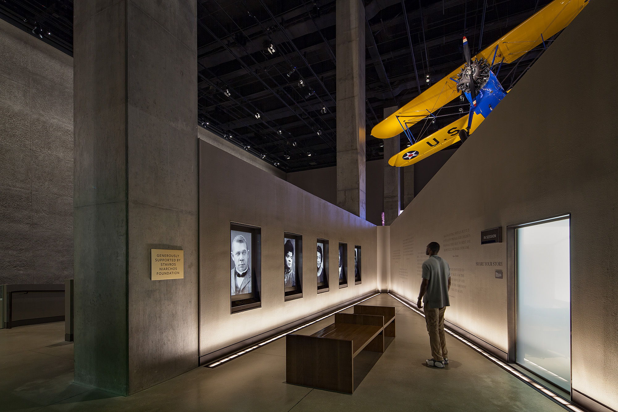 REFLECTIONS OF A GENERATION. Each History gallery has a space for reflection at the end of the gallery before rising up the ramps.  The reflection spaces s  urround the visitors with images and quotes from luminaries of the era.   Photo credit: Ron Blunt