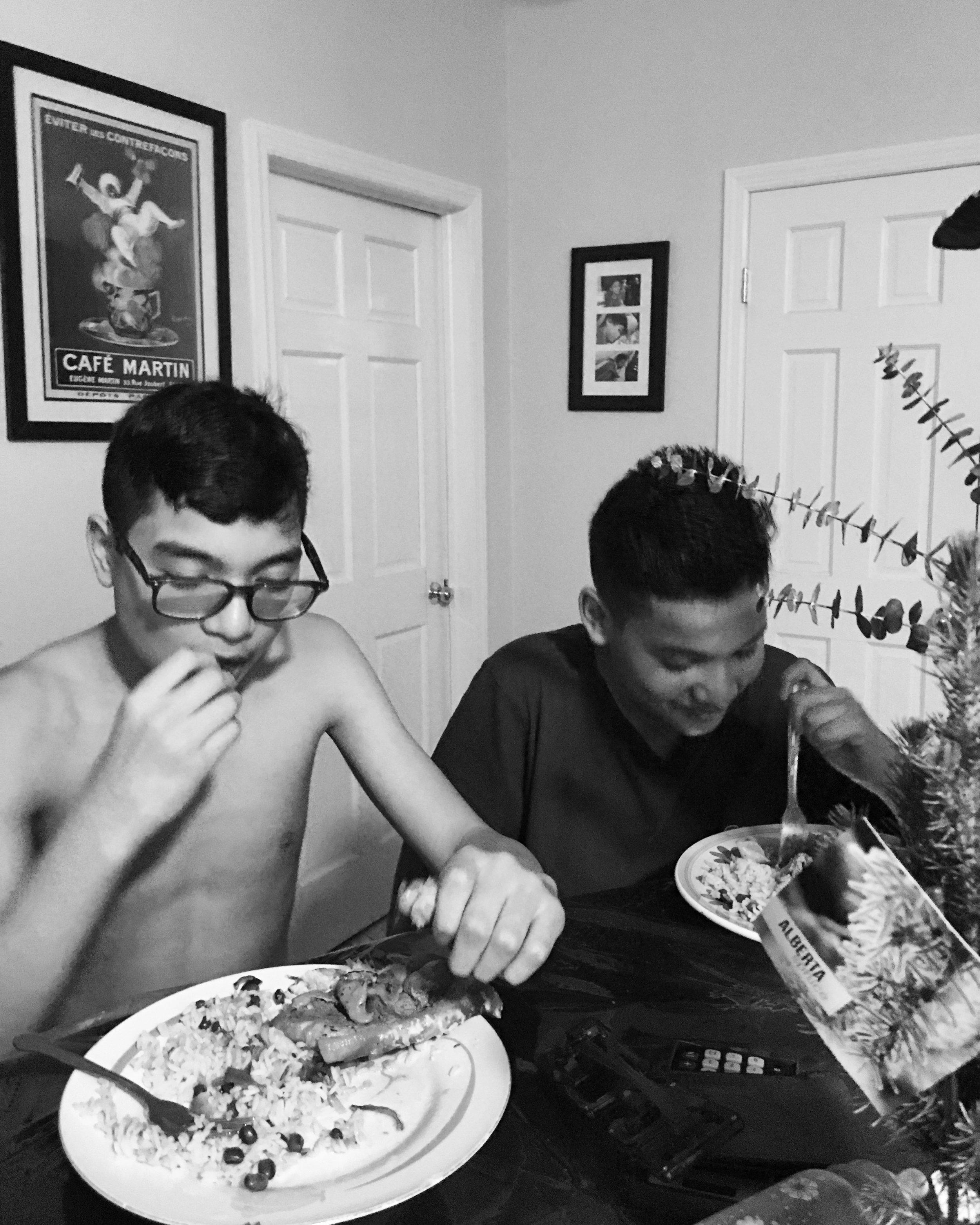 Roman and Saul Vazquez enjoying New Years Eve Dinner.