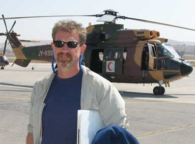 Producer and Travel Writer Jon Lapidese with Super Puma helicopter in Amman Jordan
