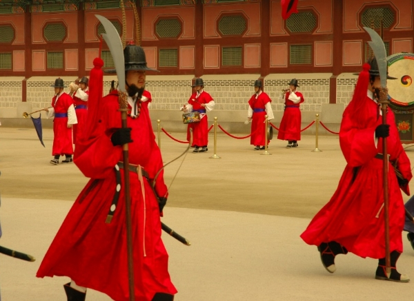 Guards dressed in traditional warrior garb outside the Palace