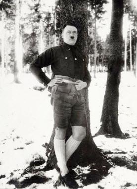 Hitler posing in leiderhosen
