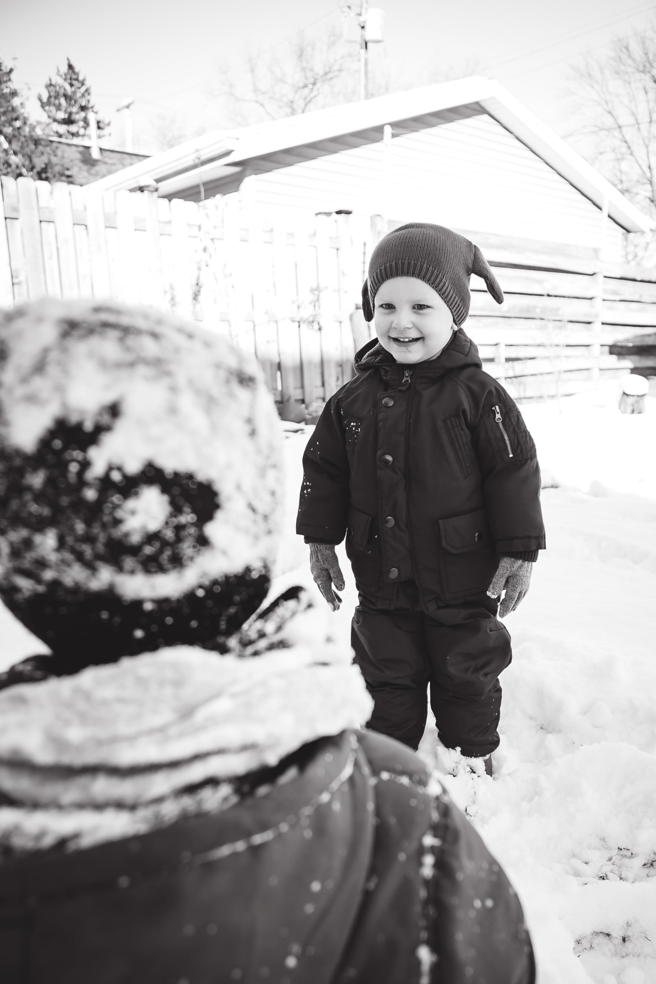 Rocco HATED the snow. The only time he was happy was this one moment. Ben can turn his frown upside down pretty easily.