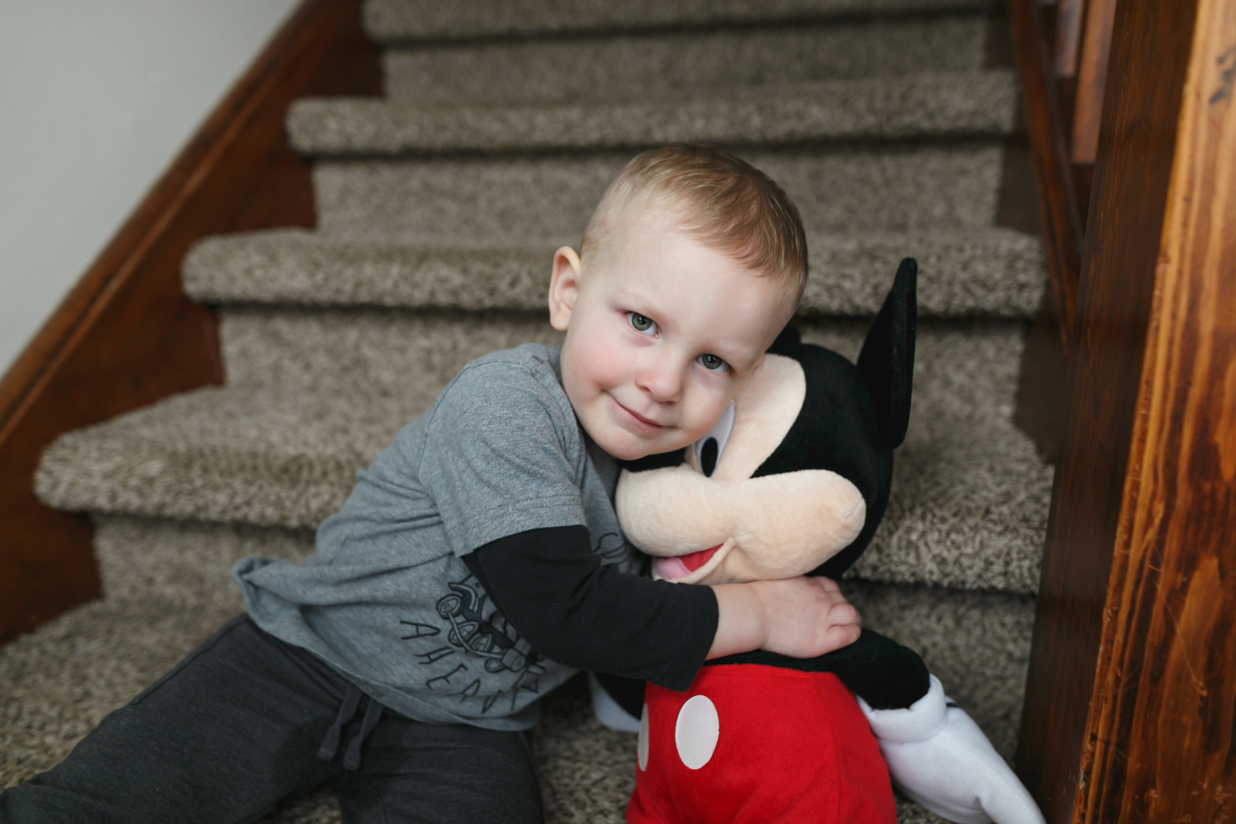 """I love his love for """"Big Huge Mickey"""" and all his other stuffed animals. He and his brother love stuffed animals, and I'm so glad. Ben still seems """"little"""" in this one area. He is growing out of all the other """"little boy"""" things. They can love on them as long as they want to, and they will still seem a little bit small."""