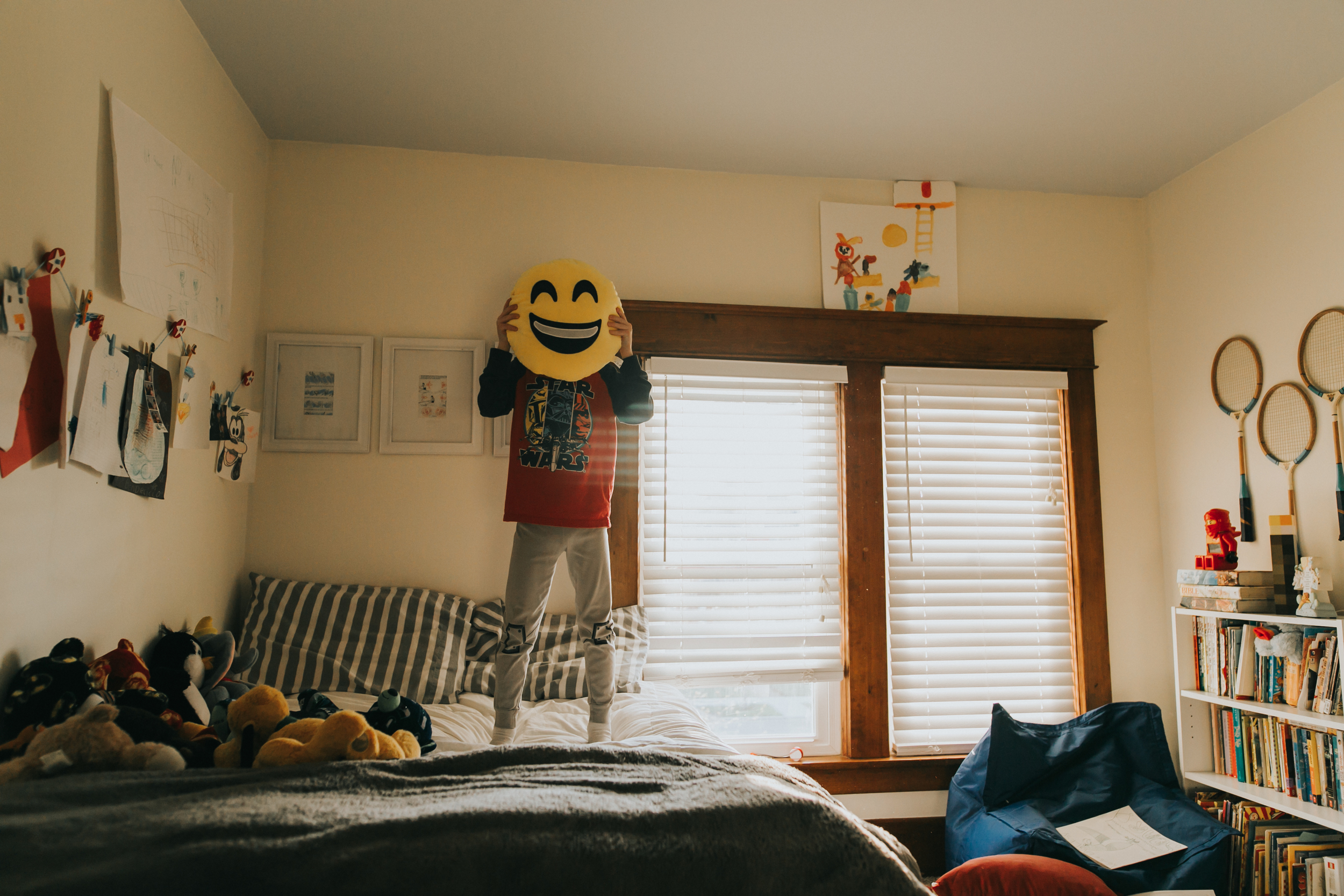 This guy loves his Emoji pillow.  I love the light in his room around 7:30 pm. <3