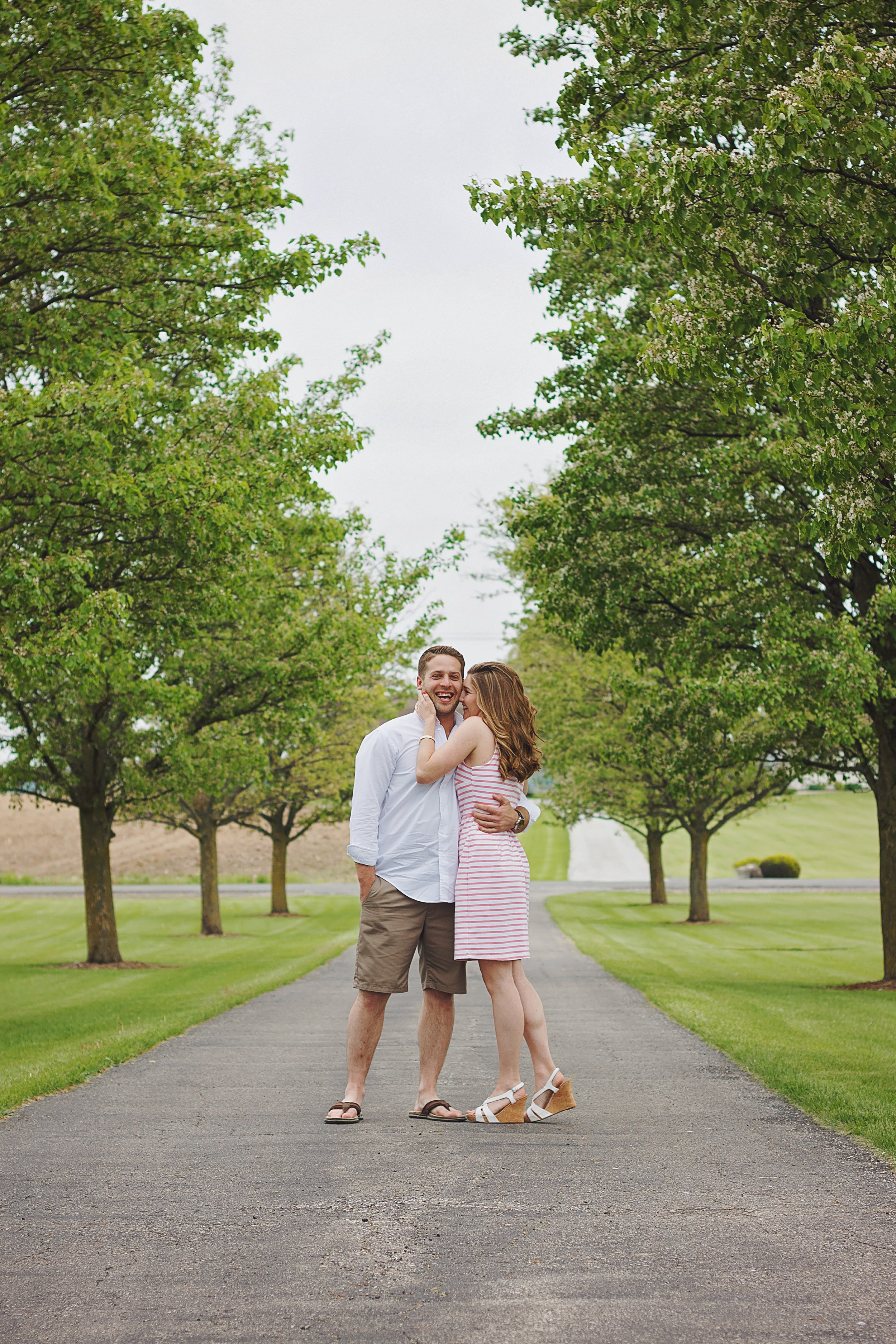 Mishawaka engagement session, family farm, pink dress, lane of trees